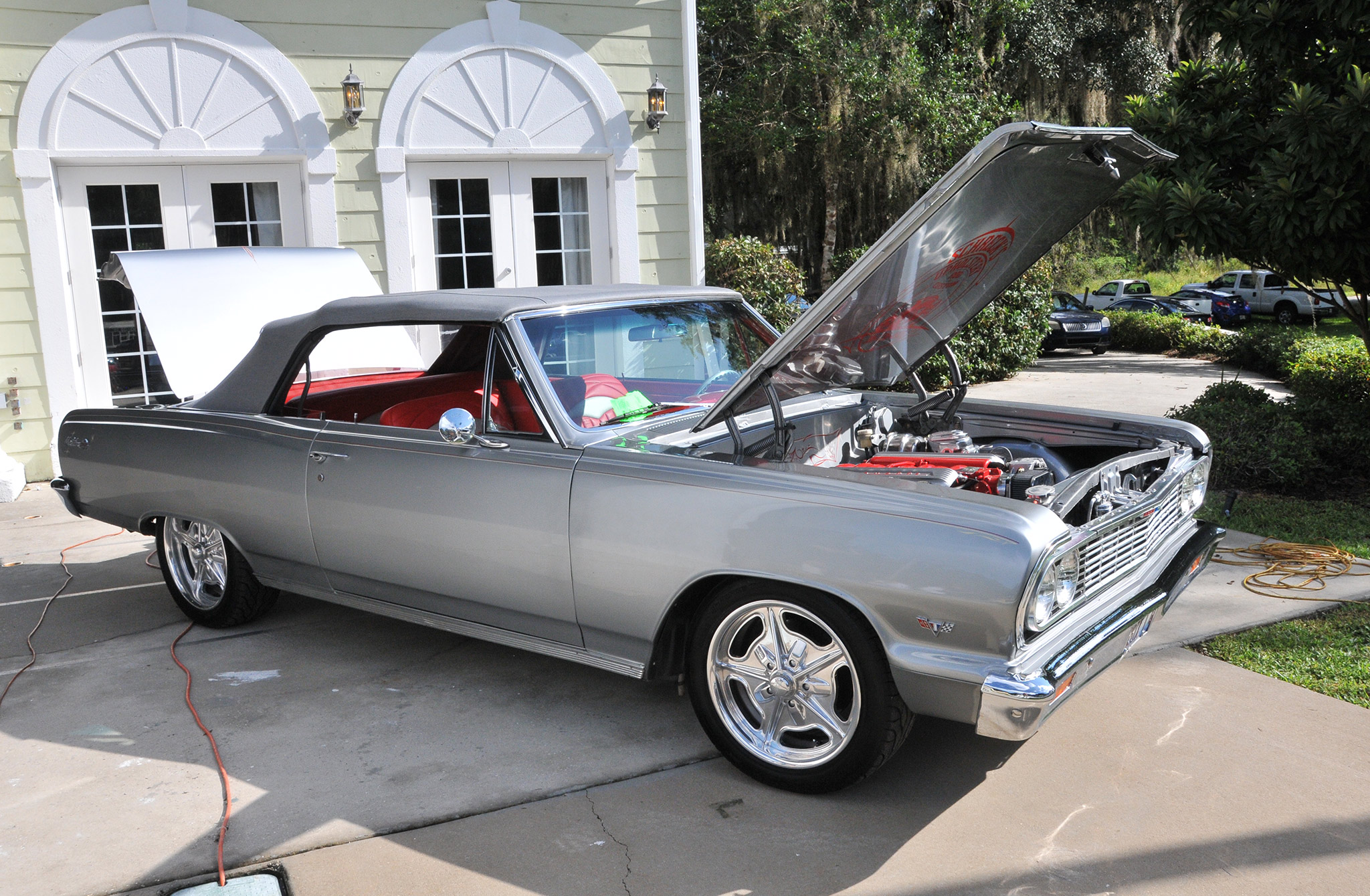 Prominently displayed on the stage was this silver '64 Malibu convertible owned by professional upholsterer Ed Schreck. It's powered by an LS1 with a six-speed trans.