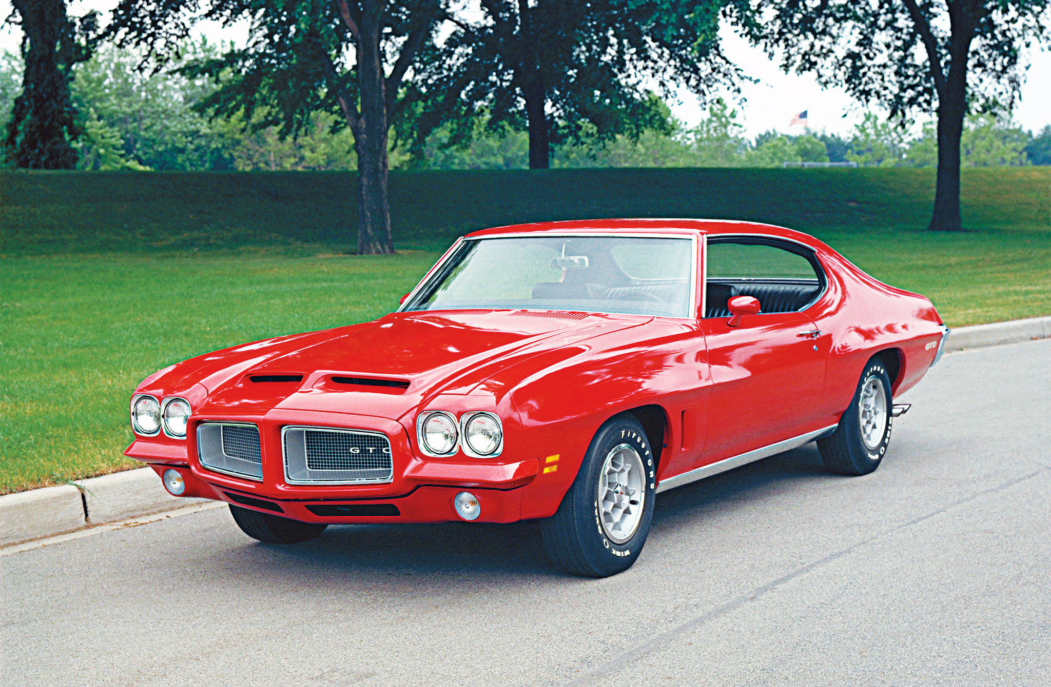 The 1972 GTO was a carry-over design from the previous year and a stopgap for the delayed next-generation A-bodies. The easiest way to tell a 1972 GTO from a 1971 is the presence of front fender-mounted air extractors and the chrome splitter exhaust tips that exit just behind the rear wheels.