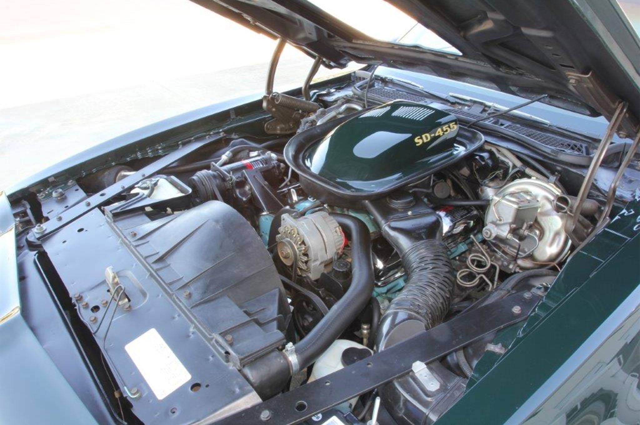 Under hood is where this Trans Am packs its punch. The SD-455 was net rated at 290 hp and 395 ft/lbslb-ft from the factory, and was capable of generating quarter quarter-miles times around 14 seconds with a trap speed of 100 mph in this configuration. The owner added chrome valve covers and eliminated the SD-455's unique PCV valve routing for improved visual appeal.