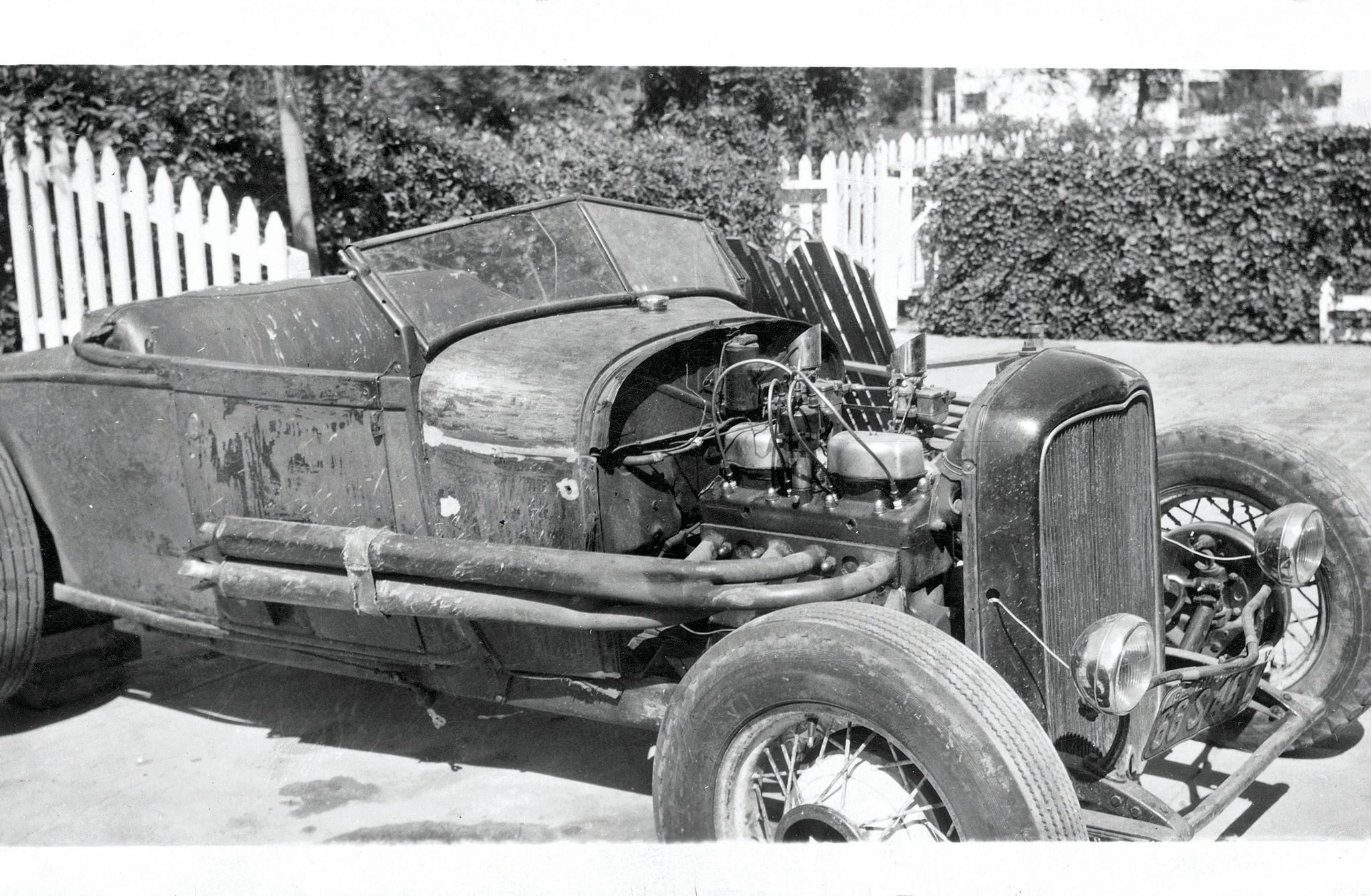 This is how Harold's Model A looked when he bought it in the mid-'40s—unpainted, fenderless, but with a Riley two-port conversion on the banger mill.