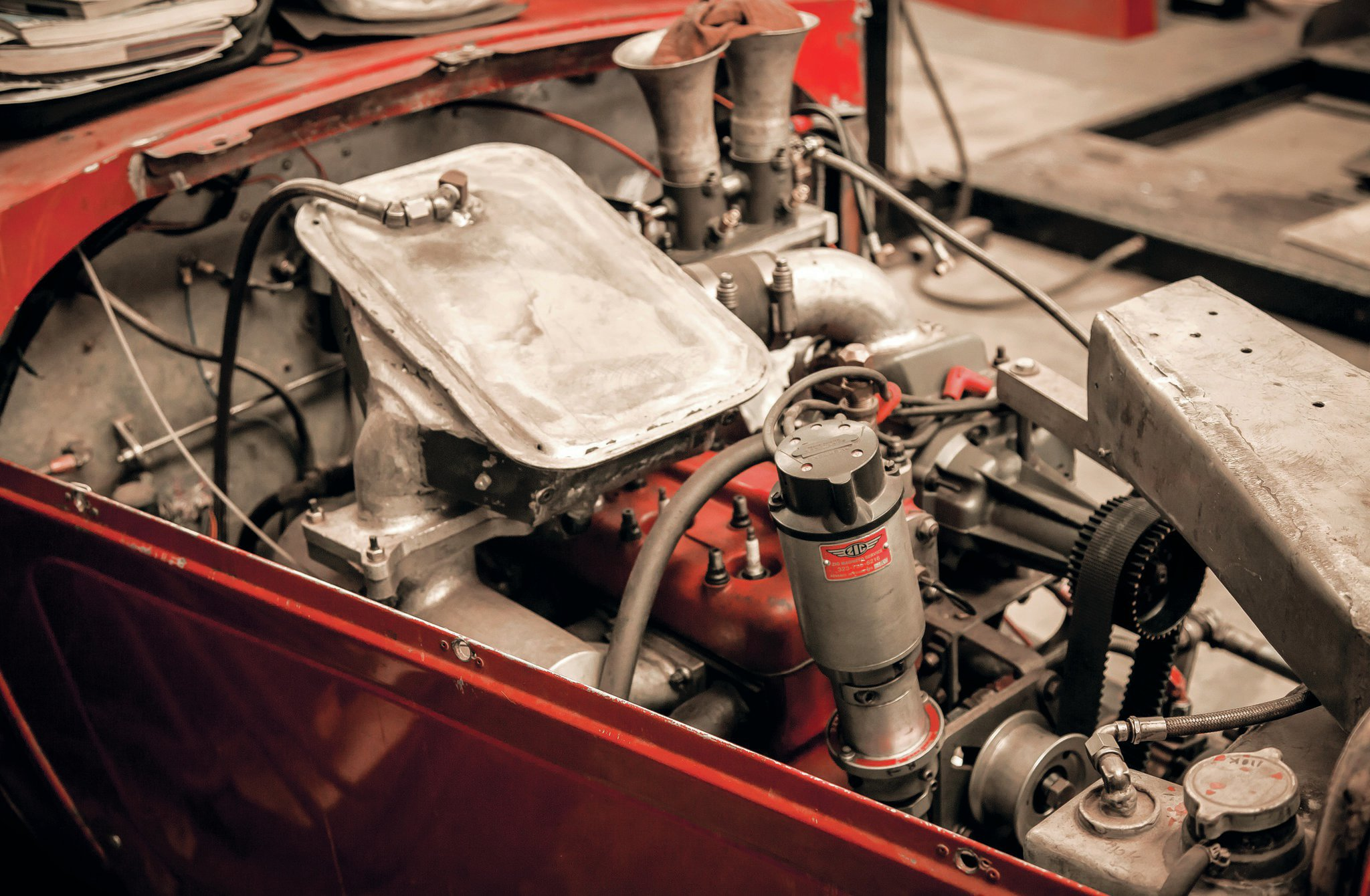 A virtual twin to 32, the number 3032 lakes roadster has a blown banger with custom-fabricated intake plenums and ducting. Harold brings a lot of experience to bear on these engines, and he's always testing new setups.