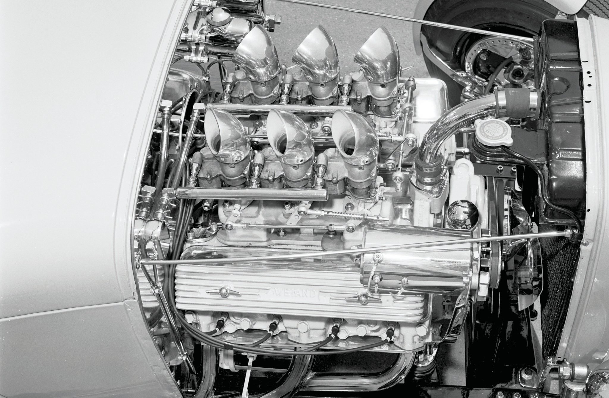 Ken gave away the Model A's original engine and transmission, and Woodie found for him a hotted-up Olds mill built by Bill Rogers. It's bored out to 338 inches and fitted with an Engle 3⁄4 cam and a Weiand Drag Star intake. Here's how it looked in 1961.