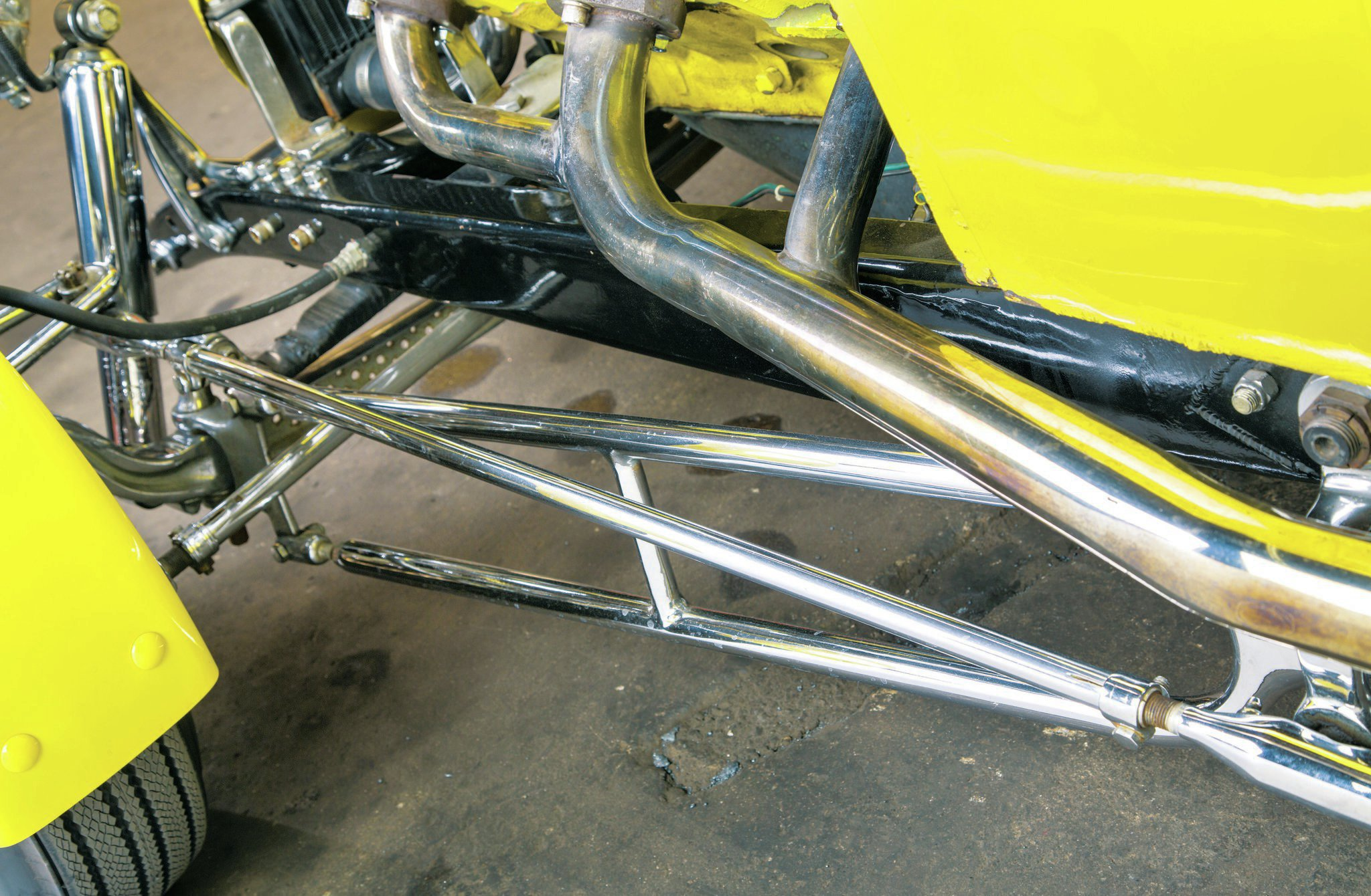 The headers, steering, and radius rods were all fabricated by Ken, plated by Woodie, and are still on the car today.