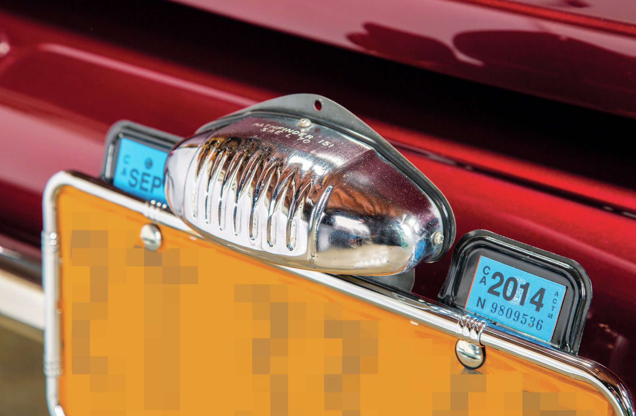 "The license plate light is another legacy part and a nice detail: ""Dad had that light for 40 or 50 years,"" Nick says. ""I have no idea what it is. A trailer light?"""