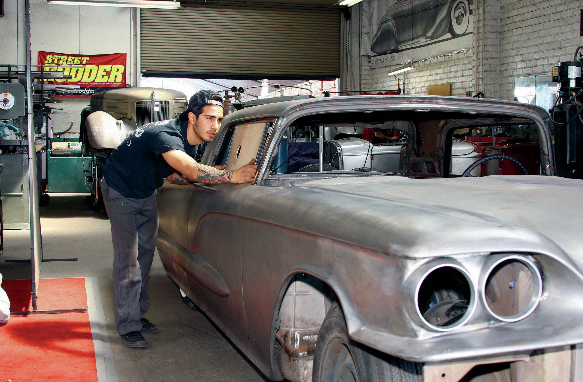 Mychal Fierro at Hollywood Hot Rods makes a visual inspection of his work on the '60 Thunderbird windows.