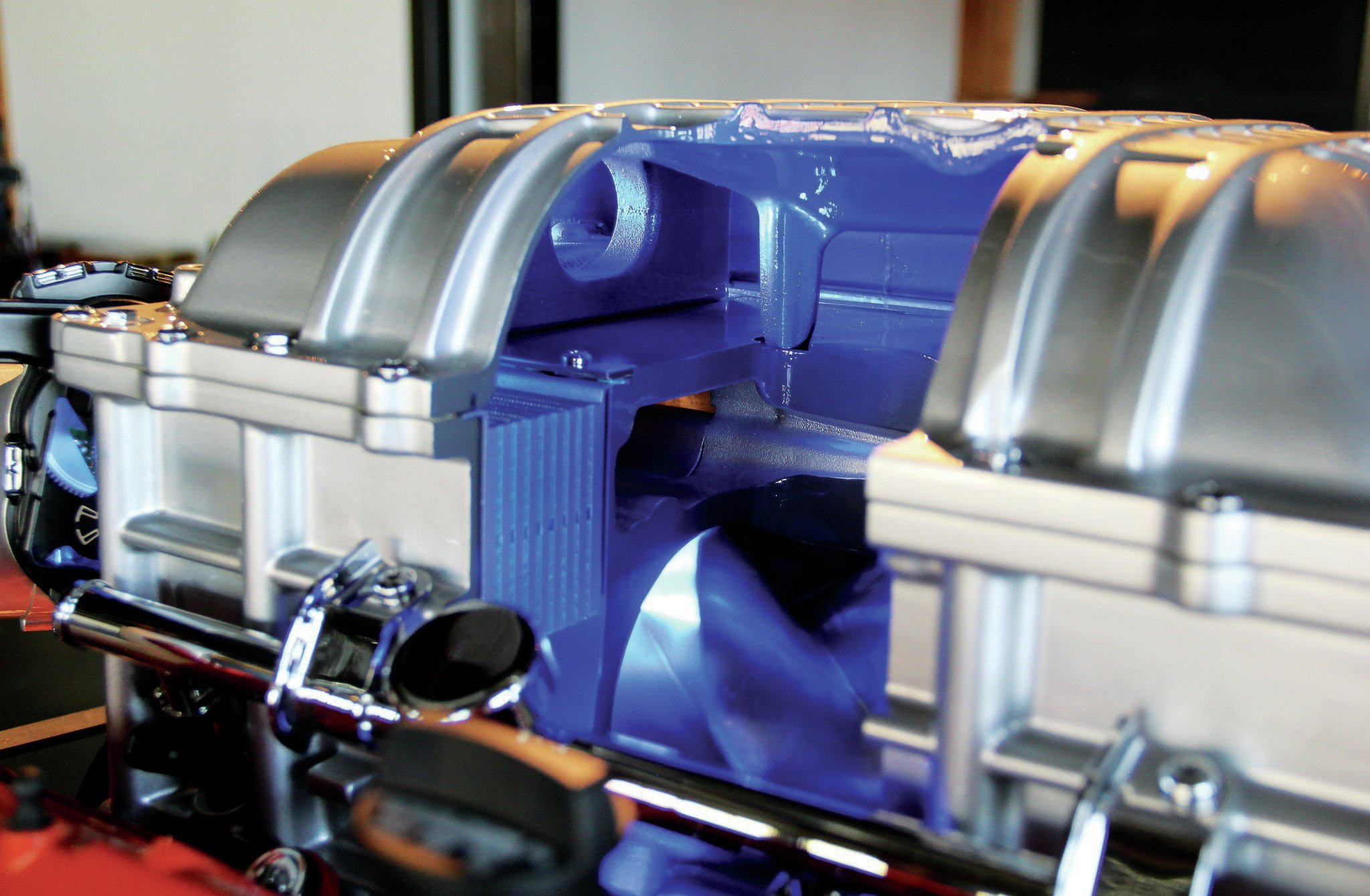 The supercharger also has two internal air-to-water charge coolers. Pressurized air is forced through these coolers into the intake ports lowering temperatures from about 248 degrees Fahrenheit to about 140 degrees.