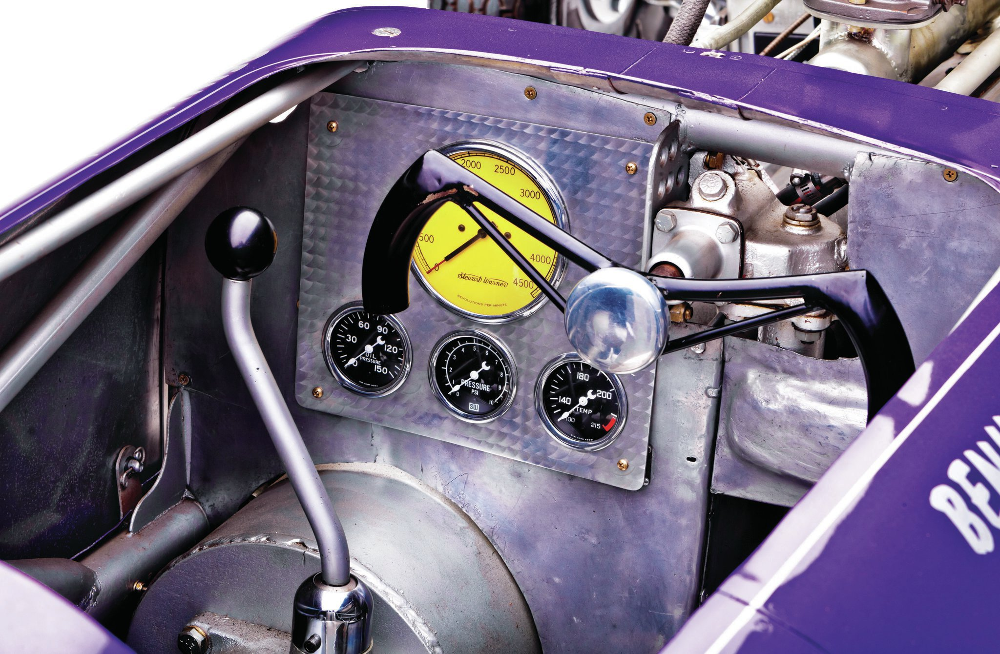 The engine isn't the only part of the Hisso that makes use of grounded airplane parts. The gauges, steering wheel, and seat are all ex-aero. The driver shares the cockpit with a 1937 Cadillac transmission.