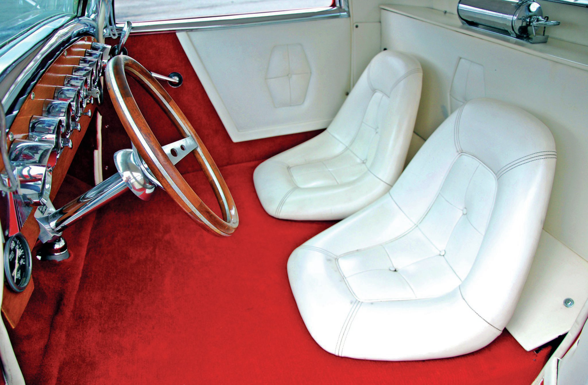 Seats were custom made to fit the shrunken cockpit, which was the result of the hot rod's heavy channel.