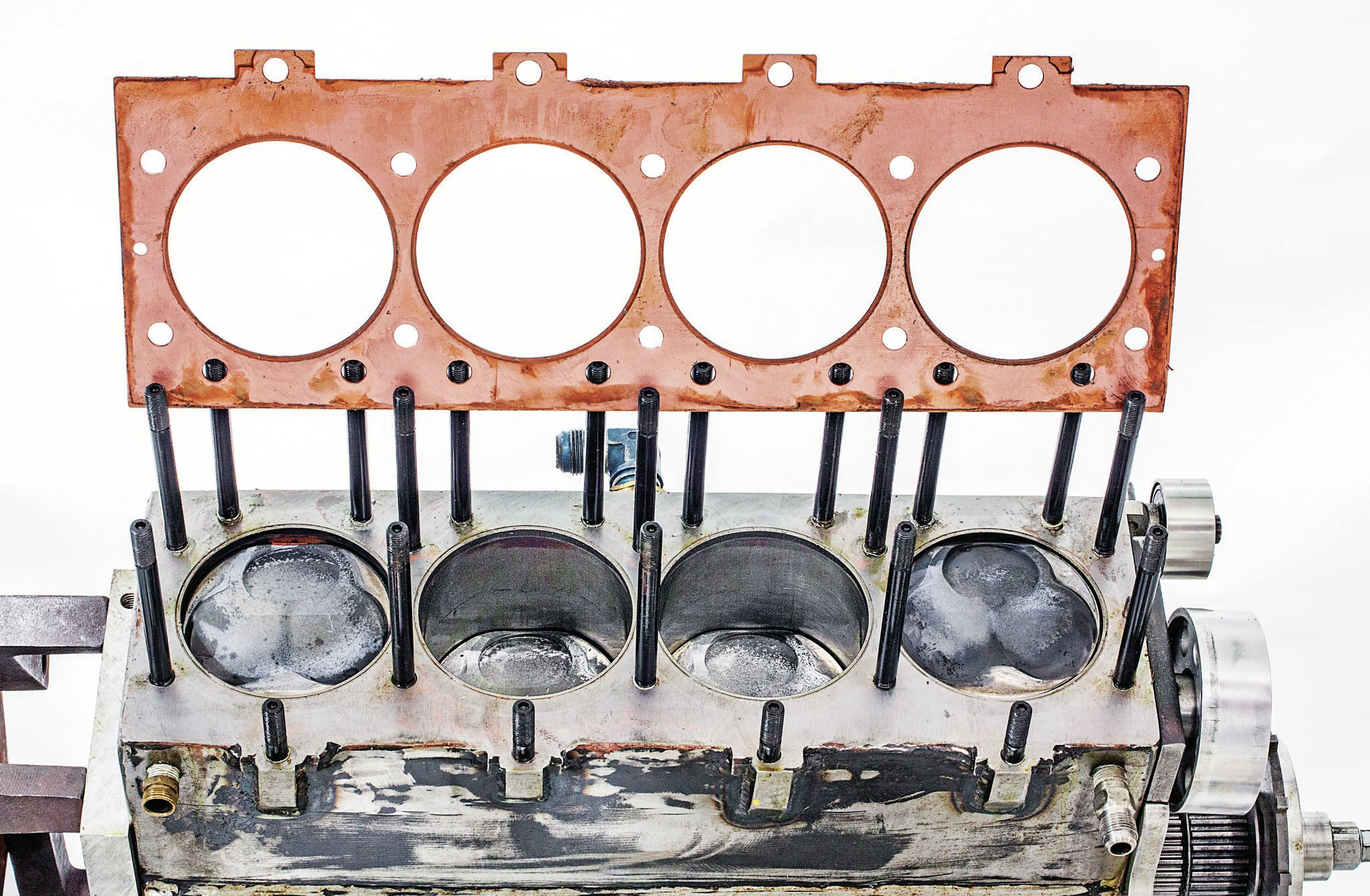 A one-off, made-to-order, Cometic solid-copper head gasket combines with stainless steel O-rings and receiver grooves cut into the head and deck to seal the head to the block. The gasket was deliberately spec'd thicker than usual—0.090-inch compressed—to get the quench right with the engine's above-the-block piston deck height.