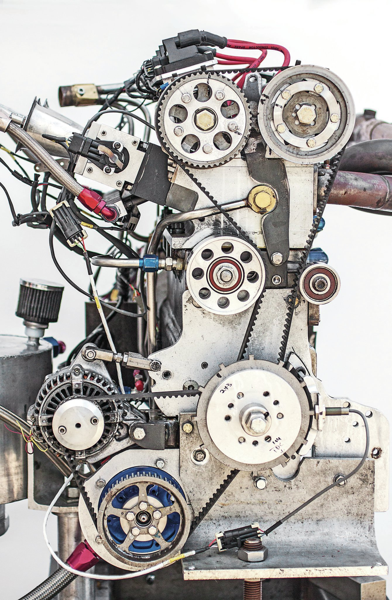 """Aardema's DOHC beltdrive setup is based around Nissan sprockets with a custom-length Gates belt. The tensioner was built in-house. Pete says, """"A chain is heavy and needs constant lubrication. We've done 100 belt-driven OHC engines, and they've proven very reliable."""""""