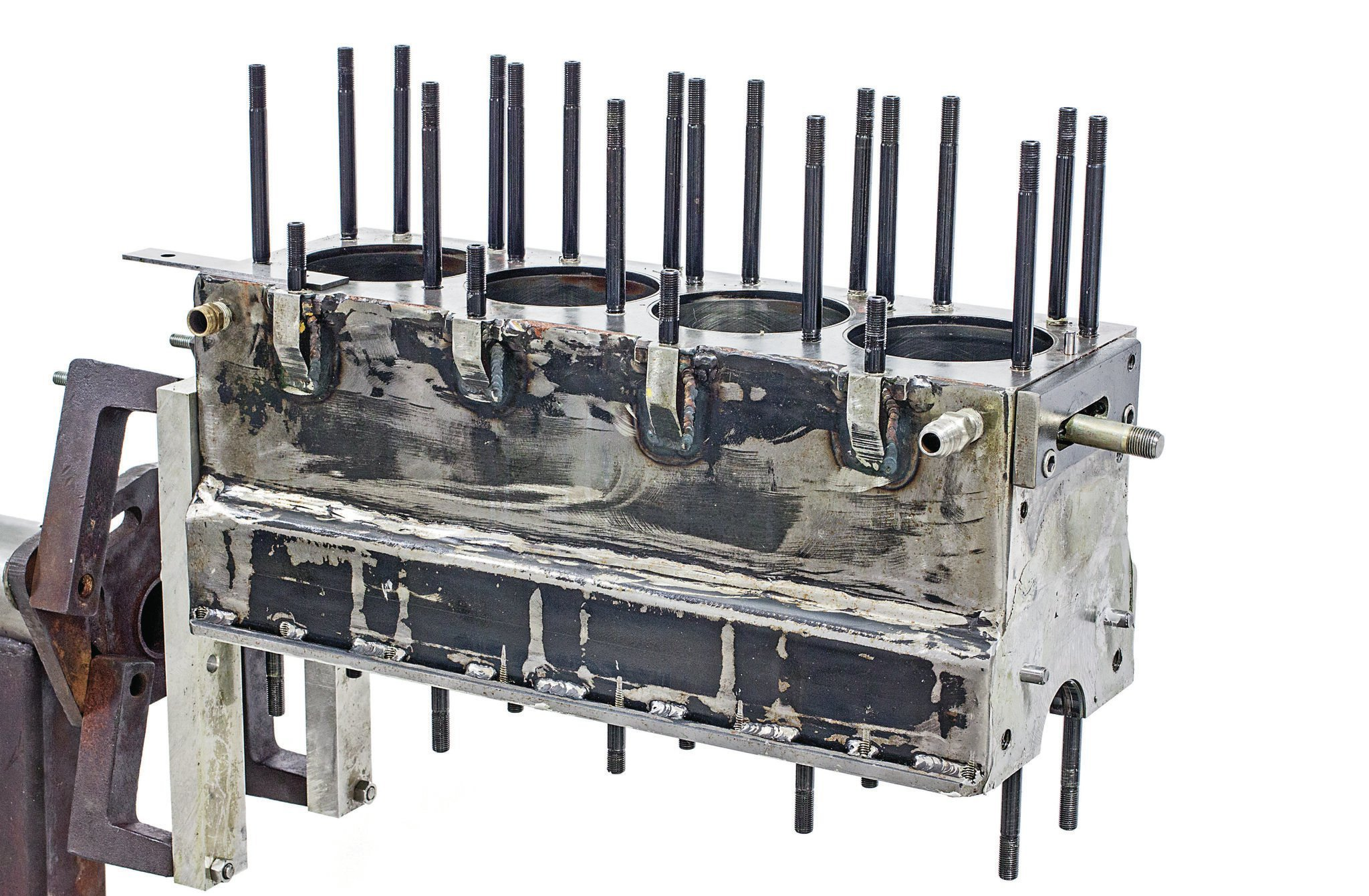 This is the complete, welded-together block assembly. The weld beads are a subtle indicator that this block is fabbed, not cast. The final step was establishing a head-bolt pattern that cleared the ports and maintains maximum gasket integrity. They ended up using 7⁄16-inch bolts, seven per cylinder. They're ARP, as are the main and rod bolts.