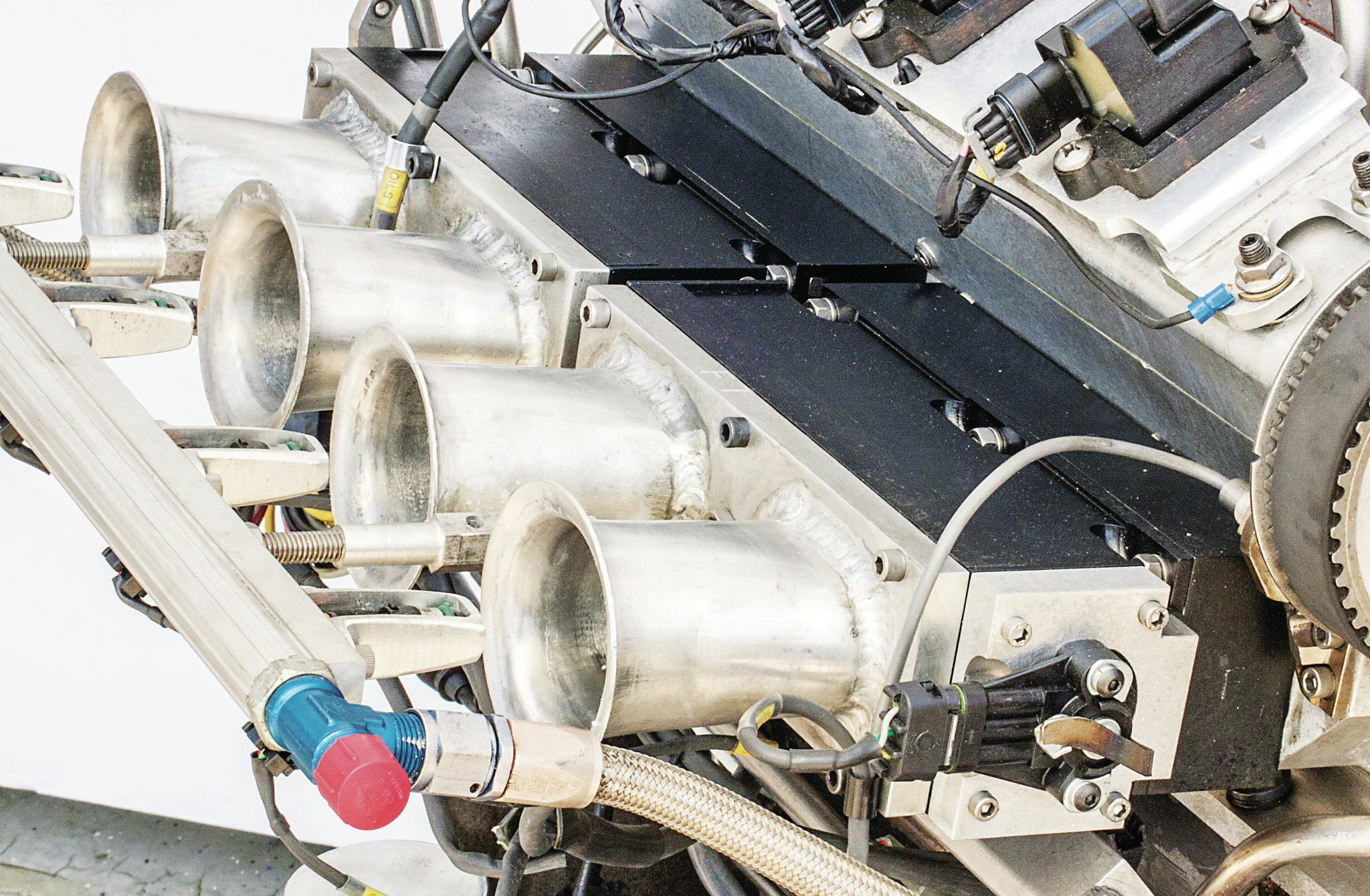 The other injectors have been moved to the top of the stacks. On Pete's setup, they come in around 4,500 rpm. Top-mounting the 39-lb/hr high-speed injectors gives the fuel more time to cool the air as it travels through the runner, increasing air density.