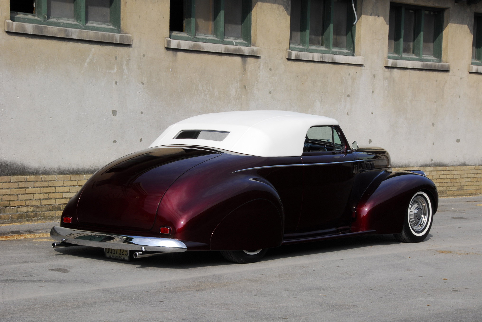 From the rear the car looks like it's melting into the pavement, thanks to a combination of RideTech 'bags, flowing rear fenders complemented by recessed skirts, and a lowered 1946 Canadian Pontiac rear bumper.
