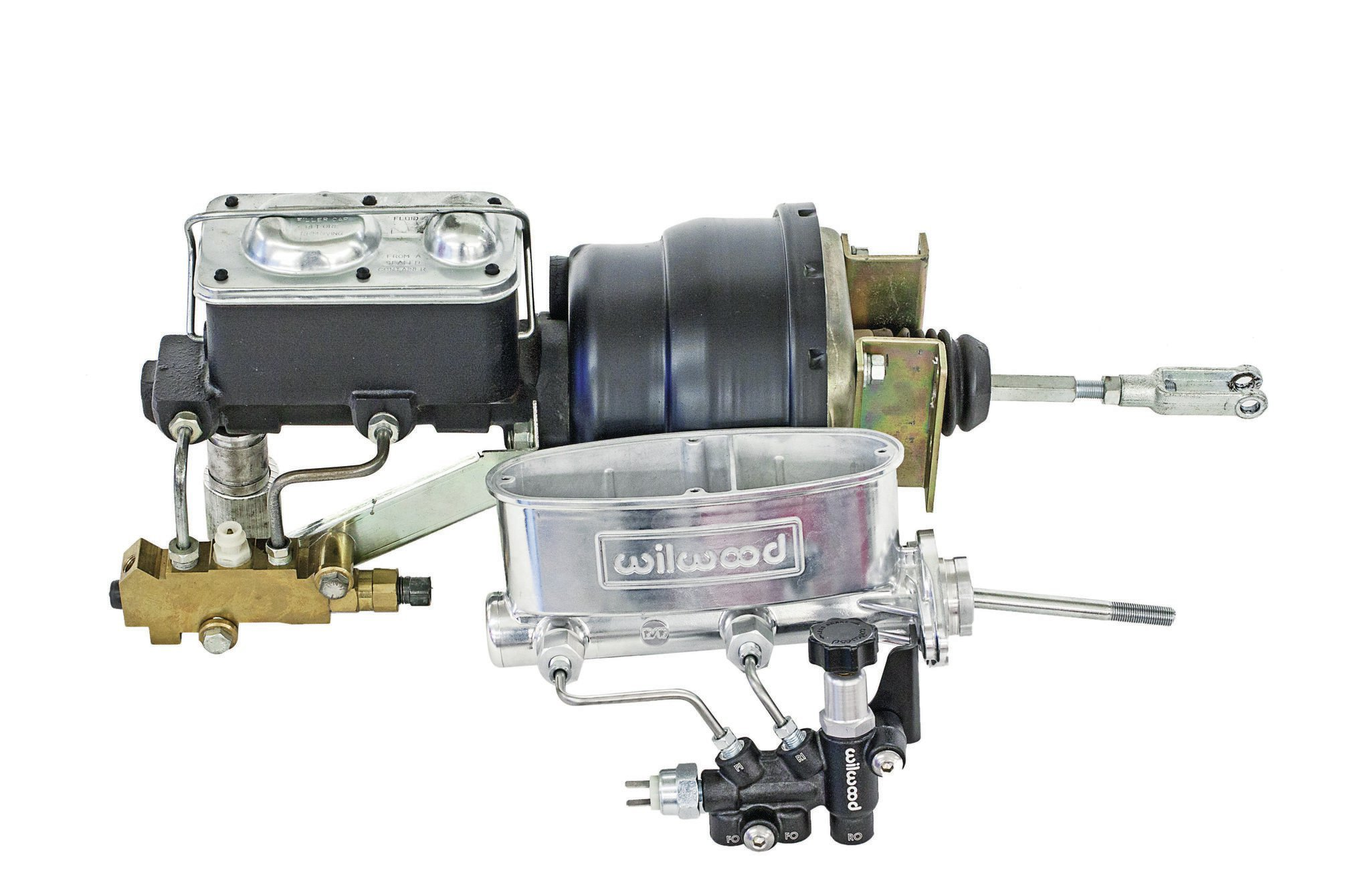 Due to low vacuum output from the tiny 7-inch-od vacuum booster, Wilwood decided to go full manual, replacing the old 15-pound booster, 11⁄8-inch bore master cylinder, and nonadjustable proportioning valve combo with its compact 3-pound, dual-tandem, 15⁄16-inch-bore aluminum master cylinder and knob-style valve.