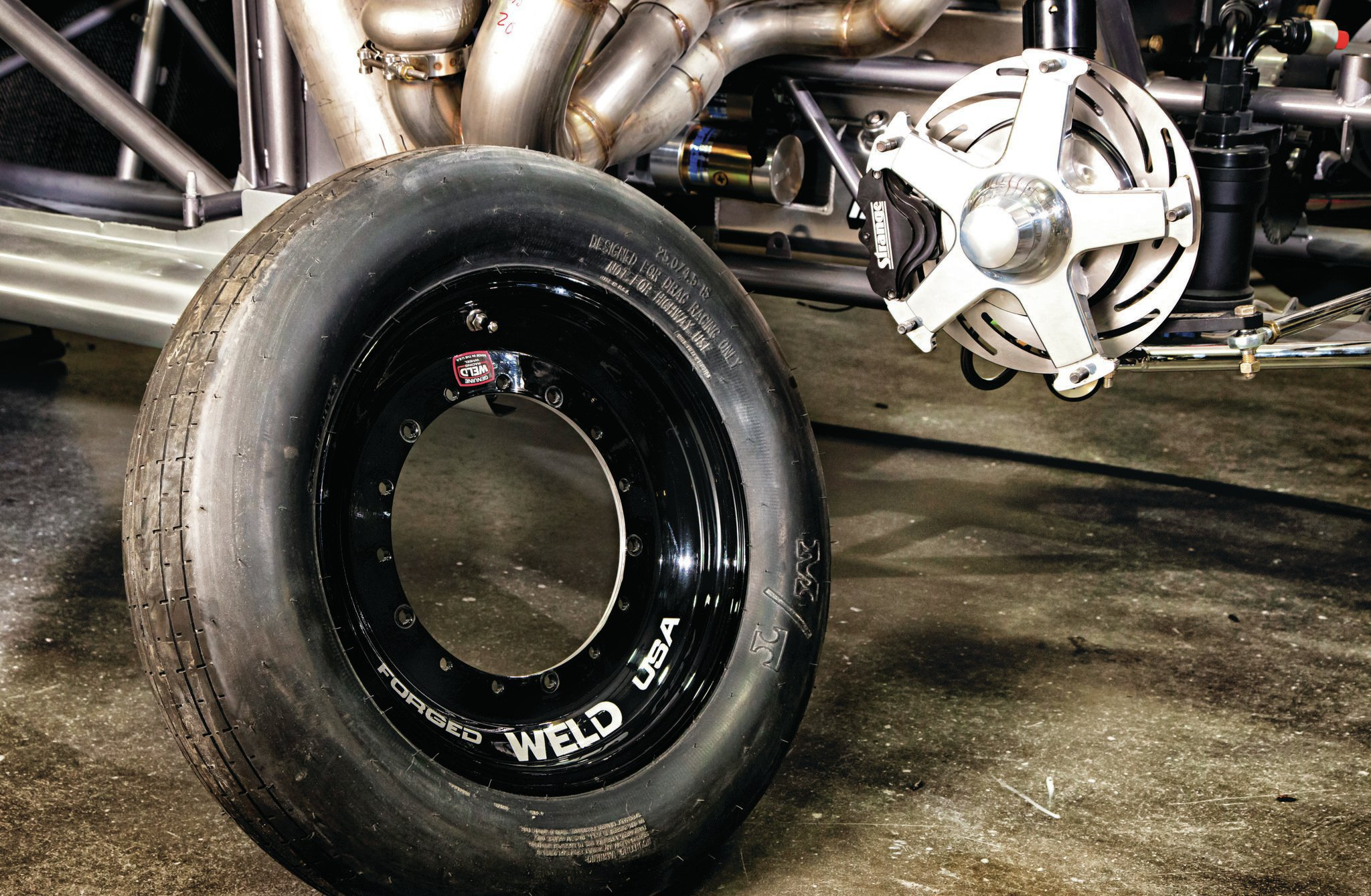 To accommodate the tire and wheel changes with a spindle-mount wheel, Weld Racing created new drag-only 15x3.5- and 15x10-inch wheels that will be called the 6-one-6 (in honor of the 6.16-second elapsed time). In recognition of the 219-mph speed, Larry's Kansas City compadres at Weld will only make 219 of them, so someone will be left with a loose spare somewhere. We bet it hangs on Larry's shop wall.