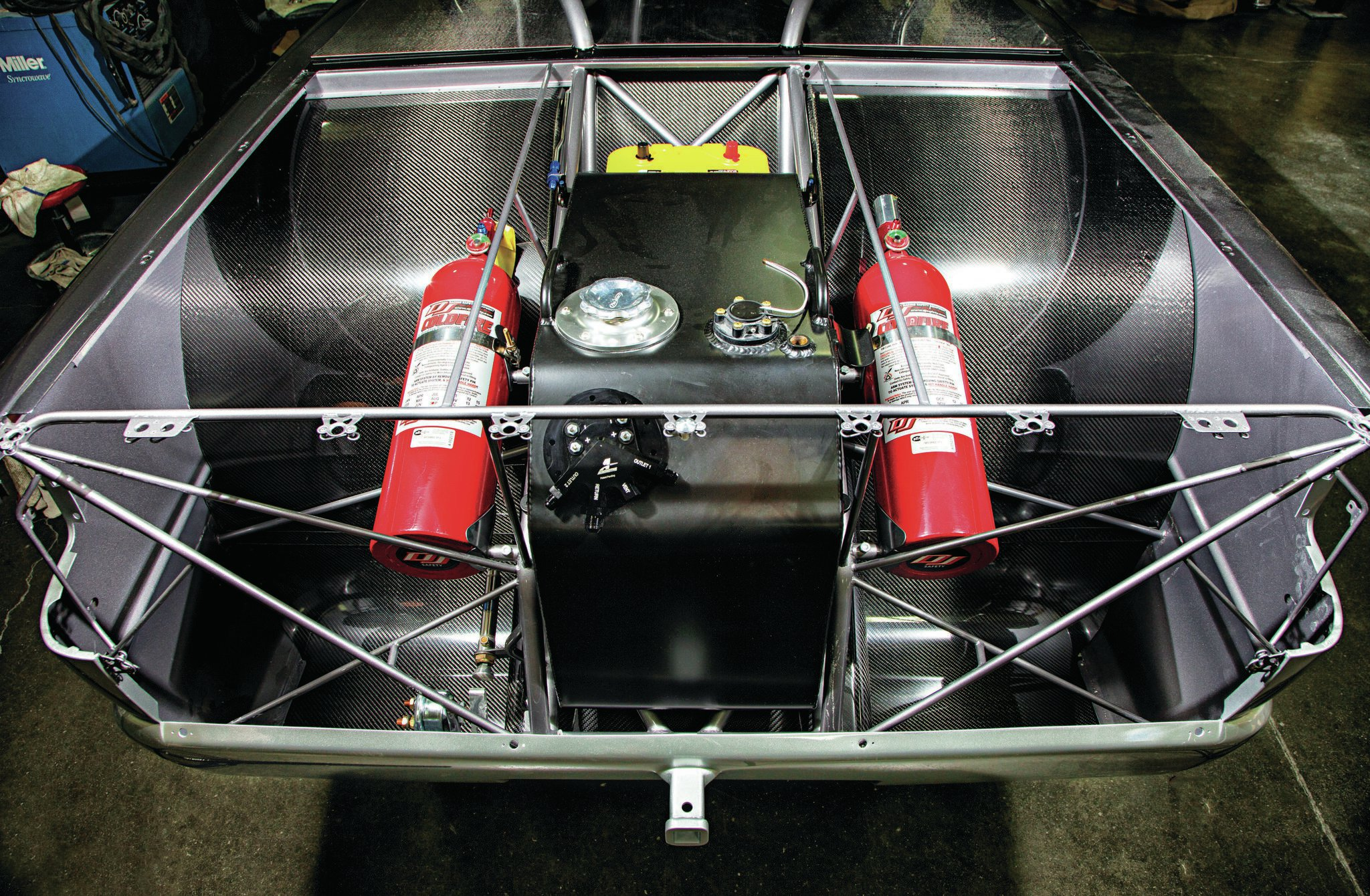 "Part of the truck's Doomsday strategy is removing ""unnecessary parts"" for the dragstrip. That includes the gasoline fuel cell, pump, and fuel filter mounted in the bed of the truck. It also includes the truck's aluminum radiator, cooling system, and side-pipe exhaust. On the track, the truck's steel doors are replaced with carbon-fiber versions."