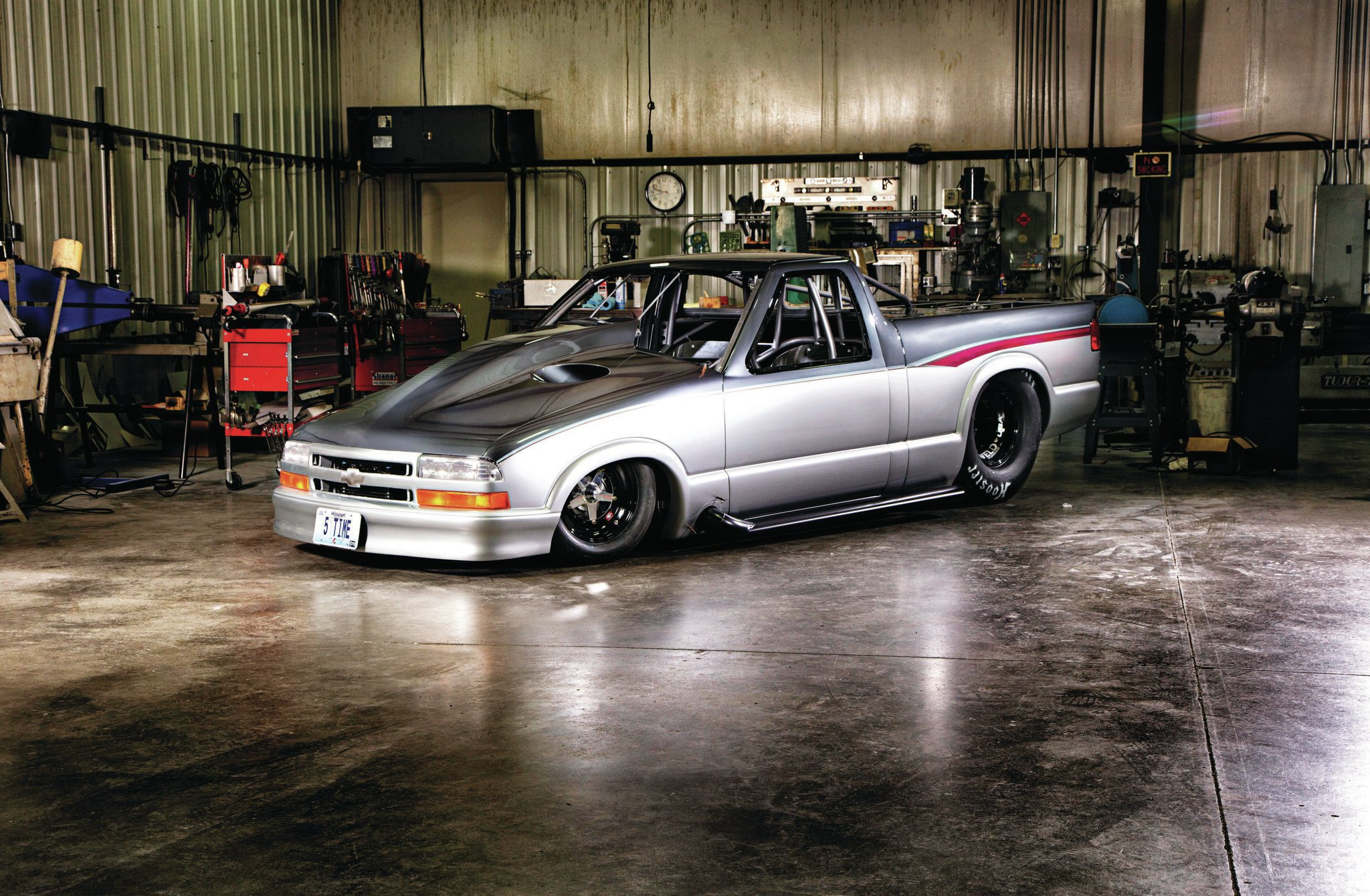 Why an S-10? Five reasons: ideal wheelbase, the steel cab is compact, the bedsides could be raised to fit 36-inch slicks, NHRA Pro Stock racing developed the aero package, and Larson could haul tools and parts in (or on) the bed instead of a pulling trailer.