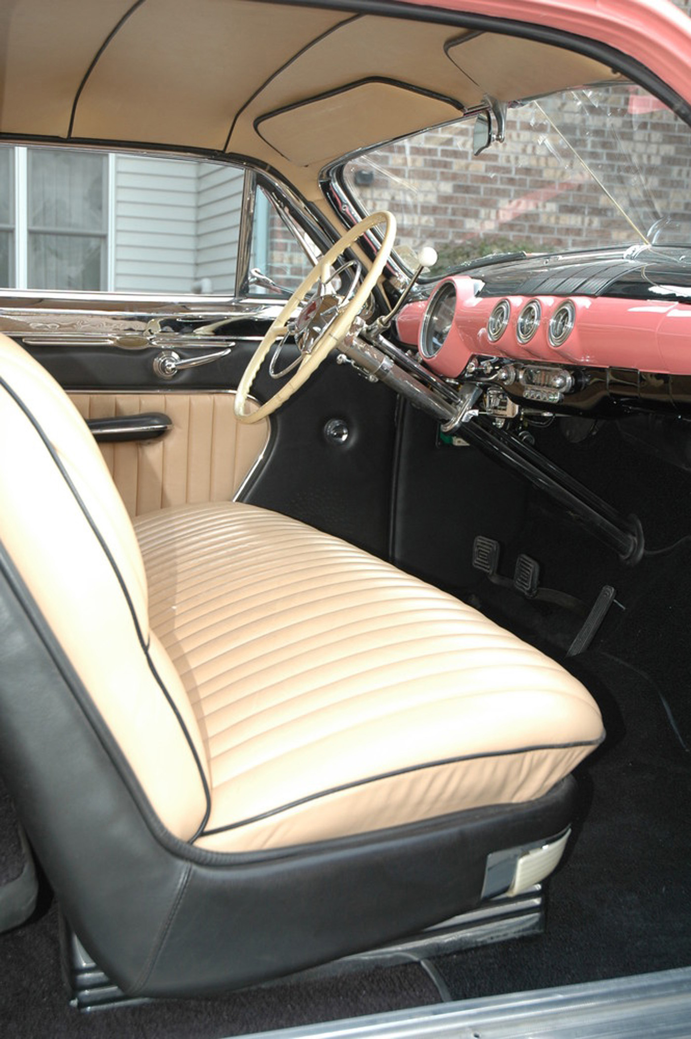 Oozing with classic charm, the interior is filled with just enough tan and black leather. John filled the dash to a triple-treat of Stewart-Warner gauges as well as a vintage 1951 Ford Crestliner steering wheel. For those long rides, a 1954 Lincoln bench with four-way power was called into service while all the trimming was handled by Rod Akey.