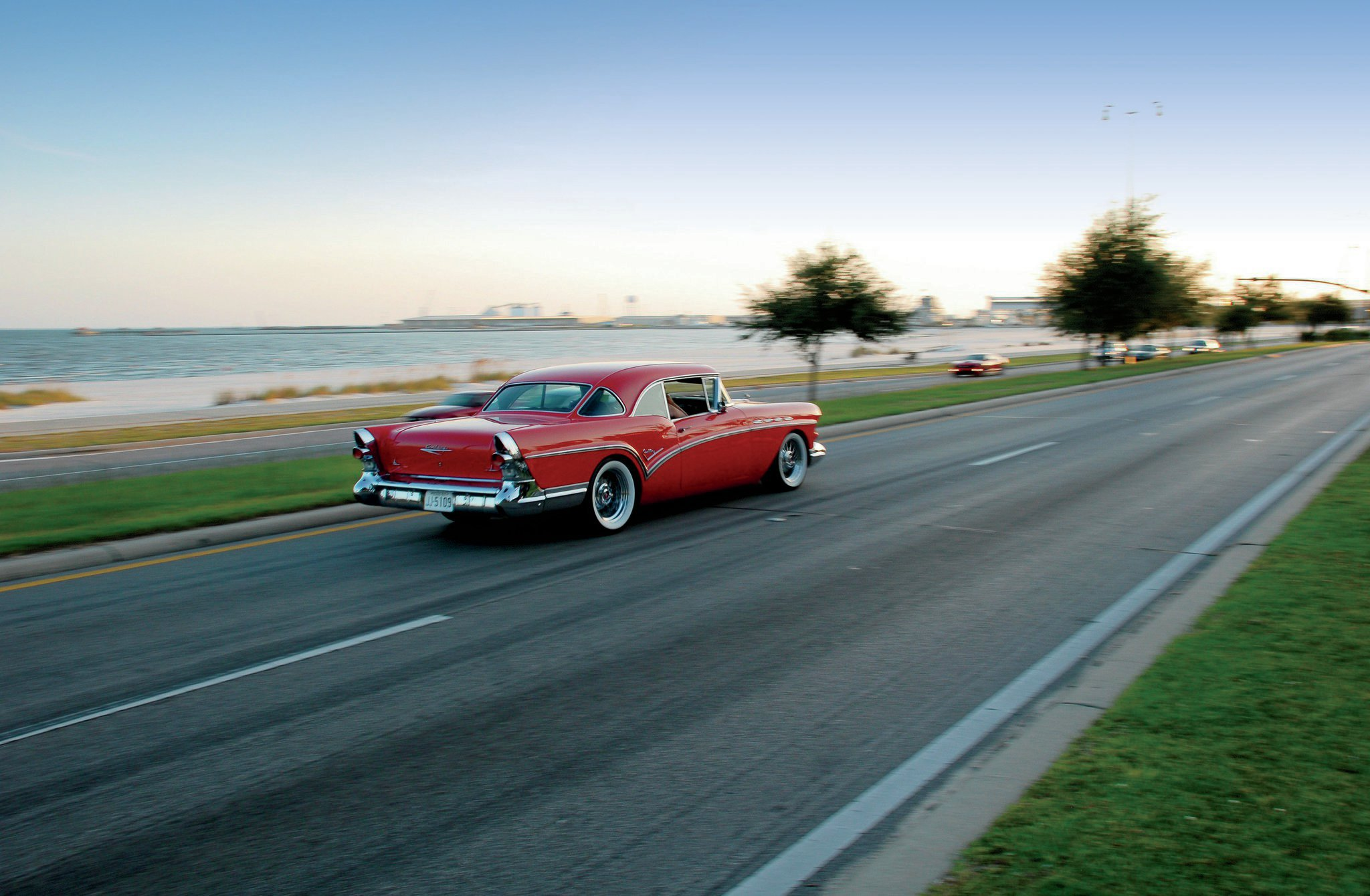 We can think of no better way to spend a warm fall evening than to be cruising down Highway 90 in a bright red '57 Buick hardtop. The rear three-window treatment is an iconic look for both the '57 Buick and Oldsmobile.