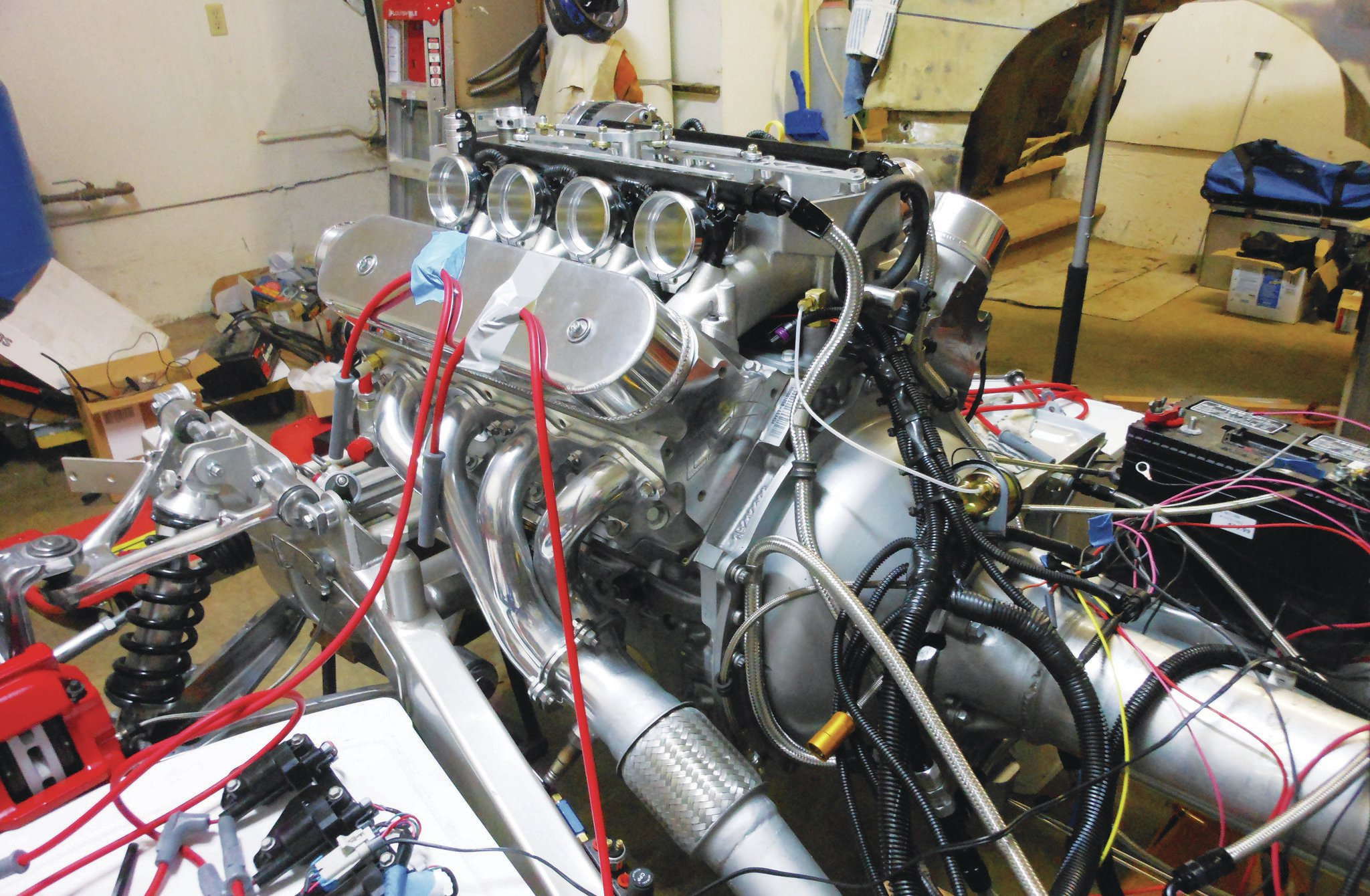 "At this stage, Paul has the Harrop Engineering (Harrop.com.au) ""Hurricane"" EFI intake, the exhaust has been constructed and installed, and wiring has commenced. He says packaging all of the electronics in a car never designed for them was the most challenging part of the build."
