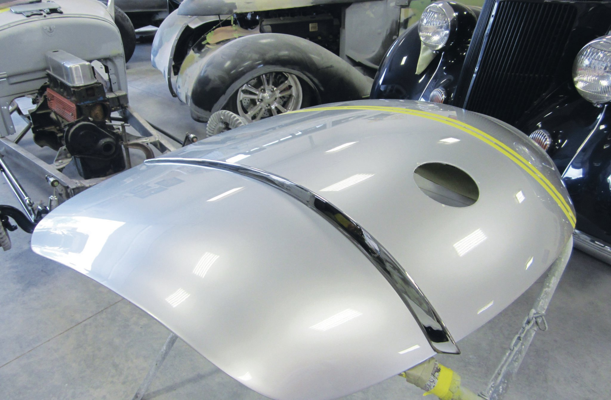 Clearcoat is on and assembly begins. Those chrome fins are one of the distinguishing features that separate the 1958 Corvette from its similar 1959–1960 brethren.