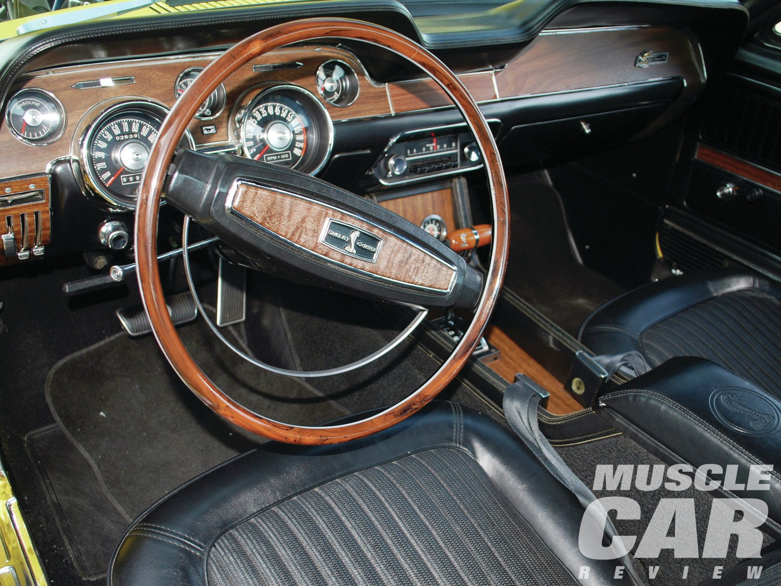 The Shelbys became more posh in the '68 model year, with interior appointments that included woodgrain vinyl inserts and a swing-away steering column to hold the T-bird–like wheel.