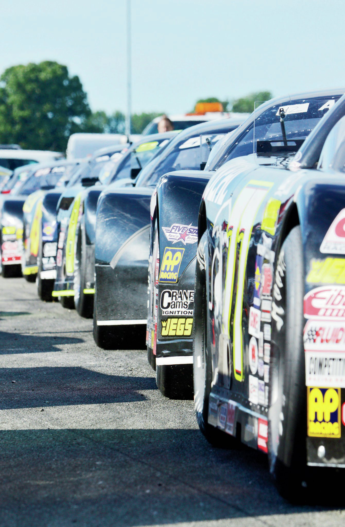 ARCA/CRA Super Series cars lined up to head out onto the starting grid.