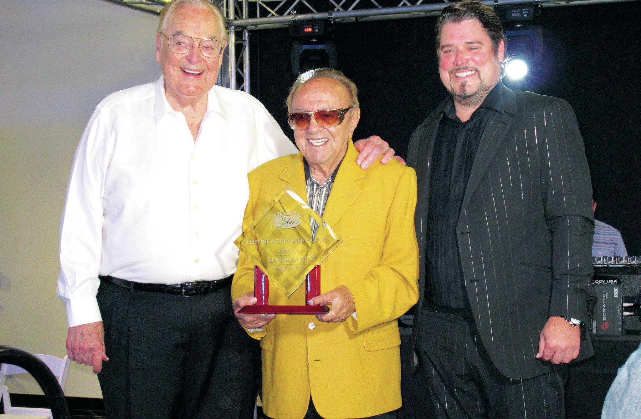Bert Boeckmann (left) and his son Beau flank George Barris as he receives Galpin Motors' Lifetime Achievement Award.