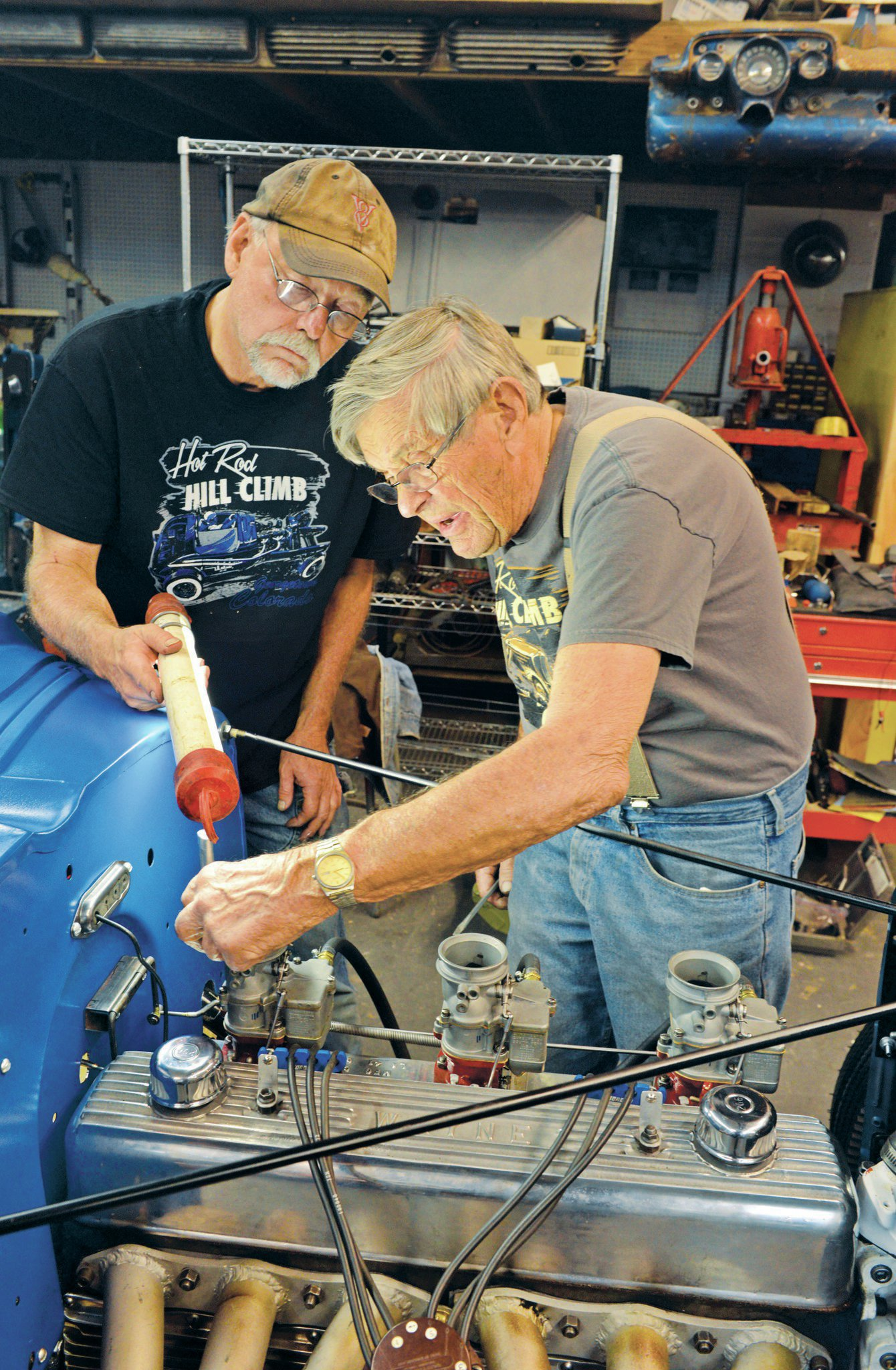 At 85 years young, Cal Kennedy is still smitten with hot rodding. When needed, he doesn't mind calling on his nearly 70 years of experience with race cars to help out on a build. Here, Cal and local hot rodder Tom Wentworth adjust the carbs on the Wayne six-banger.