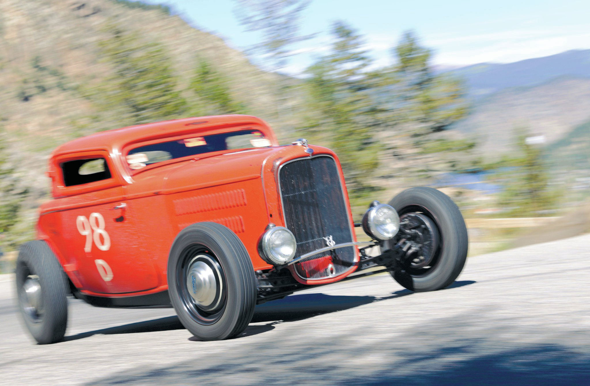 Dave Scroggs' heavily flogged Orange Peel three-window, a fixture in the Denver-area rodding scene, was a collaborative effort between Dave and the Rolling Bones Hot Rod Shop. It's built with a bored Chevy 292 that's topped with a triplet of two-barrel Rochesters. A '32 Ford axle, wishbones, and a quick-change rear with original Ford bells make up the meat of this build. Dave's late father, Don, is a legend in these hills, taking home a class win in the '54 HRHC with partner Cal Kennedy.