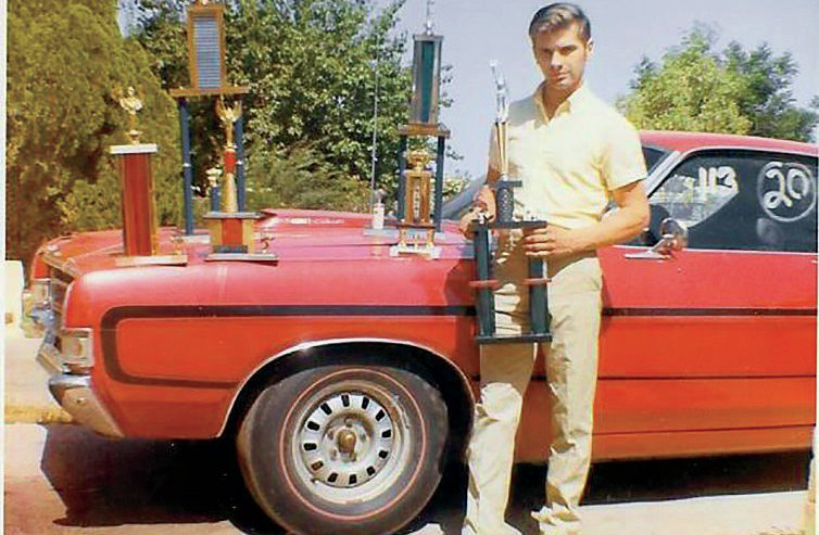 Neil poses with the Torino he drag raced. The photo was taken in the early '70s.