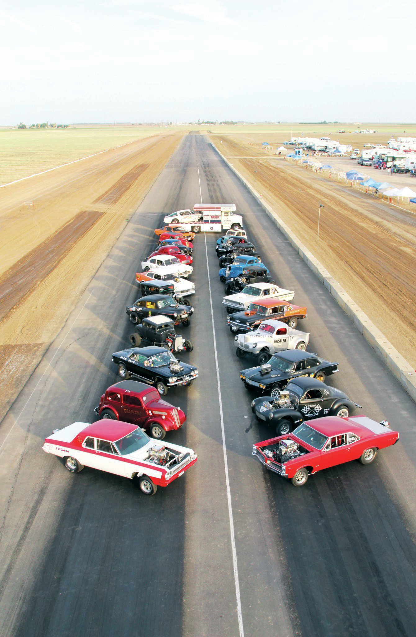 The 24-plus-car field for Sunday's gasser war came together for a group photo Saturday evening. The group consisted of original gassers from the '60s and new builds, all competing against each other for trophies and bragging rights.