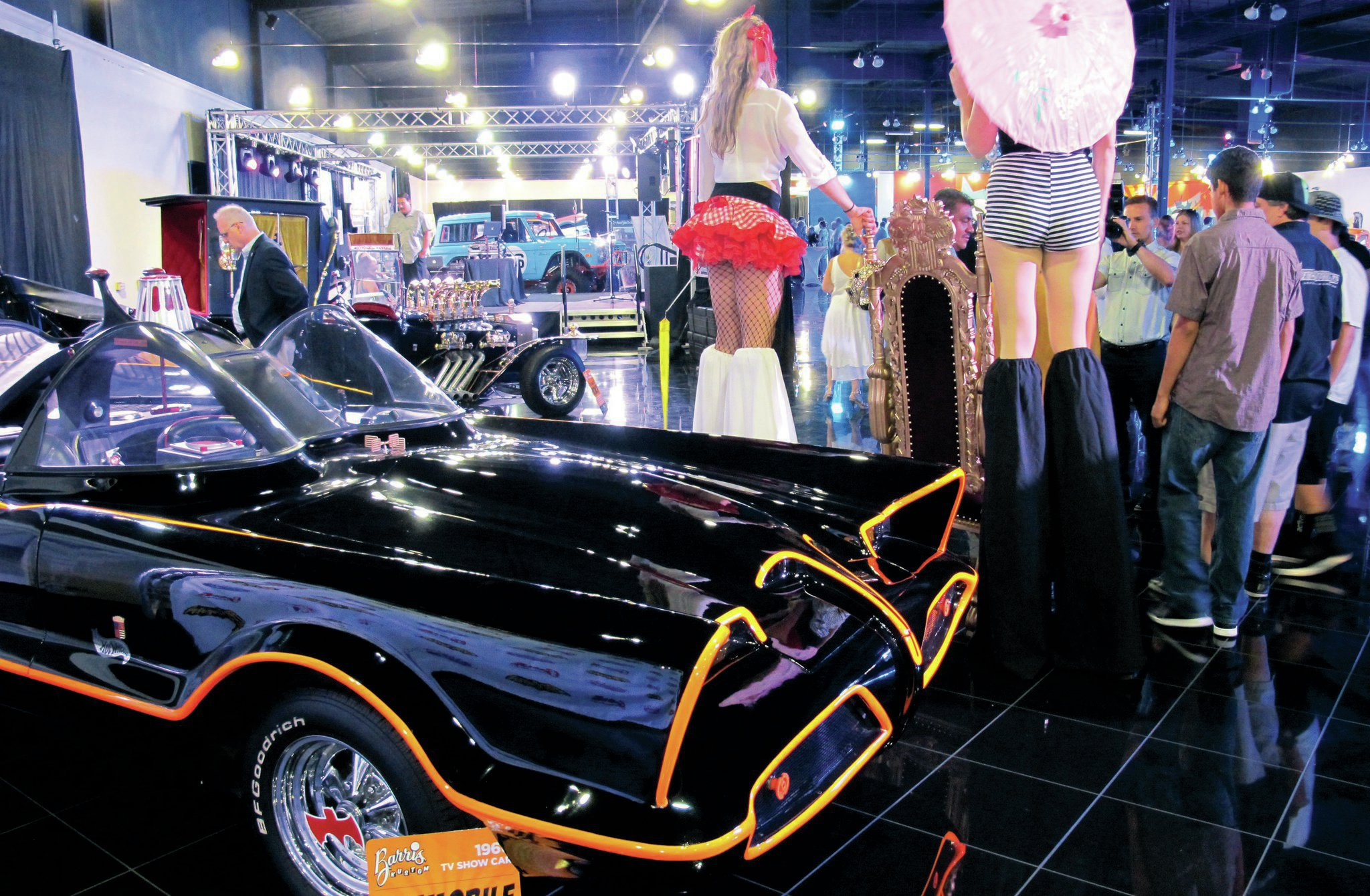 This was the scene that greeted partygoers as they entered Galpin Auto Sports for the Barris shindig. It was wild. We weren't quite sure what was going on with the super-tall models until we saw that Barris was holding court in front of the Batmobile while fans could have their pictures taken with him—and those leggy models.