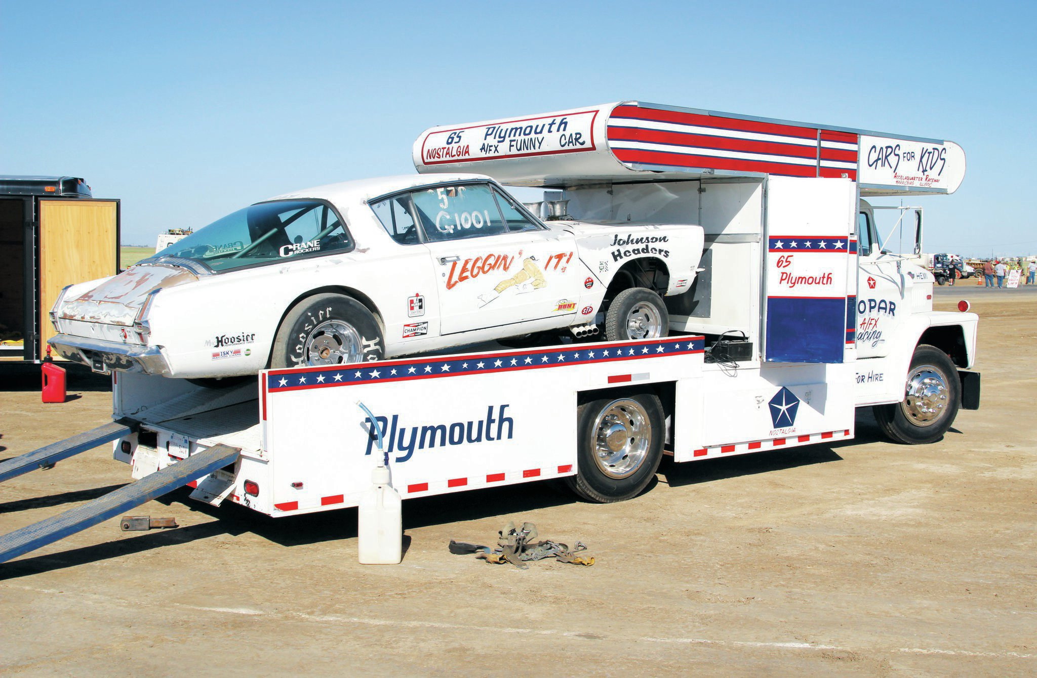 Joe Hickenbottom also brought his newly acquired ramp truck, which bears a striking resemblance to the Snake and Mongoose haulers of the '70s. Joe already owned the '65 'Cuda gasser, so the signage on the truck was a perfect match to haul his car to the races. Eagle Field was the maiden voyage for the truck, which is powered by a 318 Polysphere engine with a two-barrel Holly carburetor.