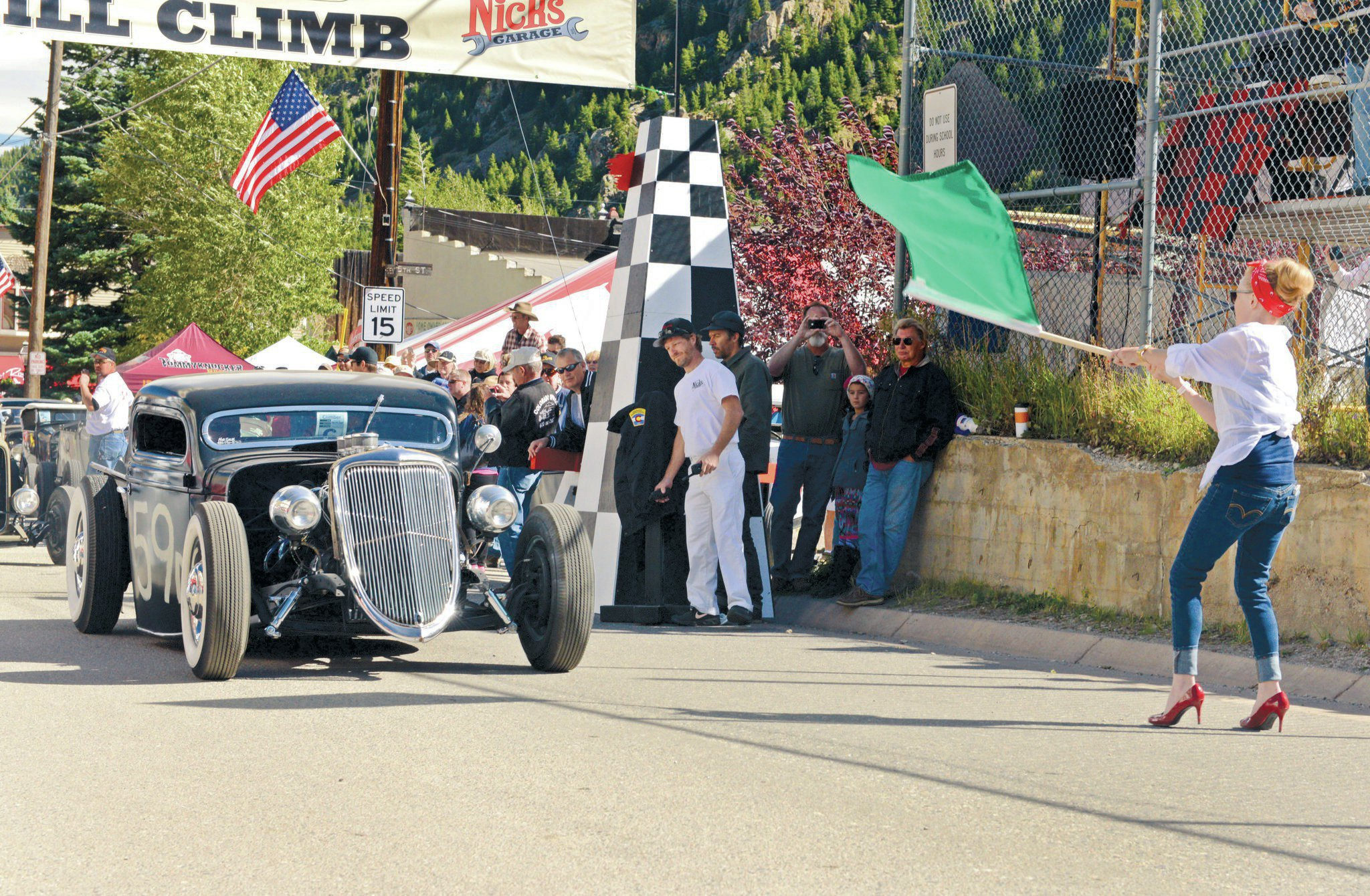 Kayleena Bambina gets the participants moving at the starting line. Here, Woody Bair heads off the line in his '36 Ford pickup powered by a 365ci Caddy motor. This is Woody's backup ride; his Model A had a catastrophic failure on the way to the Hill Climb.