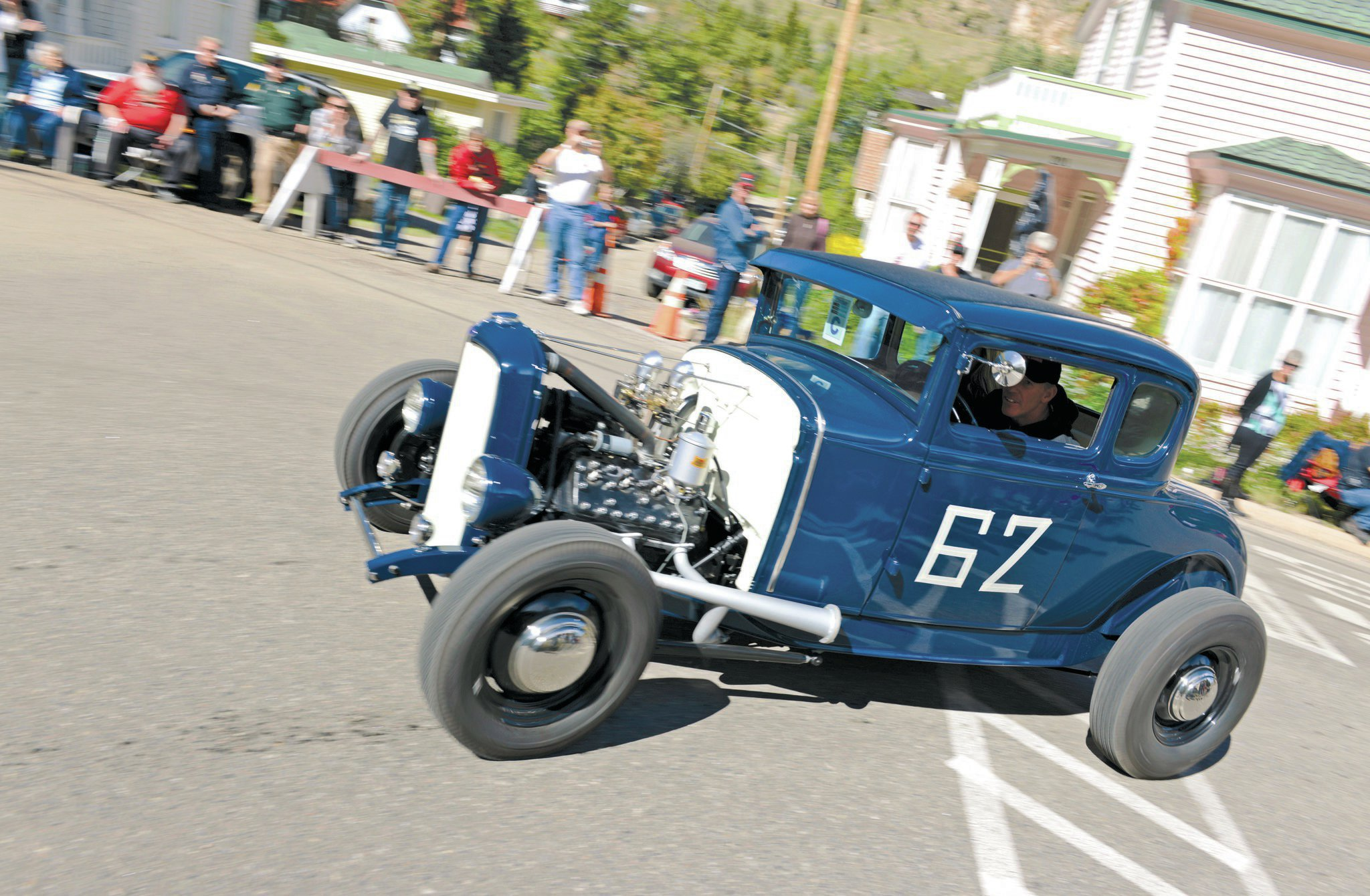 Cutting this corner tight is Kevin Tutor and his '31 Model A highboy. It's got a 3-inch chop, a '32 frame with split wishbones, and a 4-inch dropped axle. Powering this stunner is a '59 flathead with a Thickstun PM7 manifold, topped by a pair of Stromberg carbs.