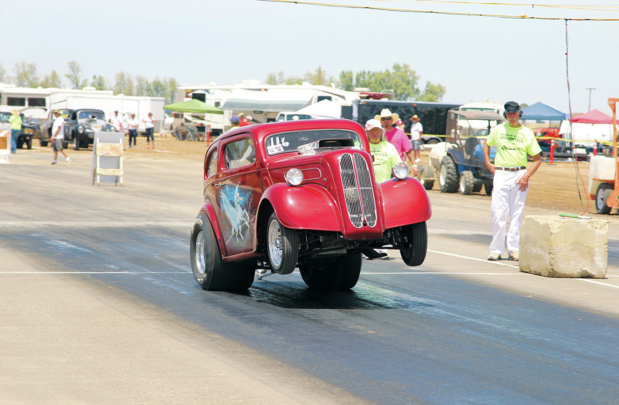 With only soda syrup (like you'd find in restaurants) sprayed down to aid in traction, Mike Acquistapace managed to pull a huge wheelstand in his Anglia. Soda syrup was a common traction compound for dragstrips in the '60s before the creation of the modern VHT traction compound.