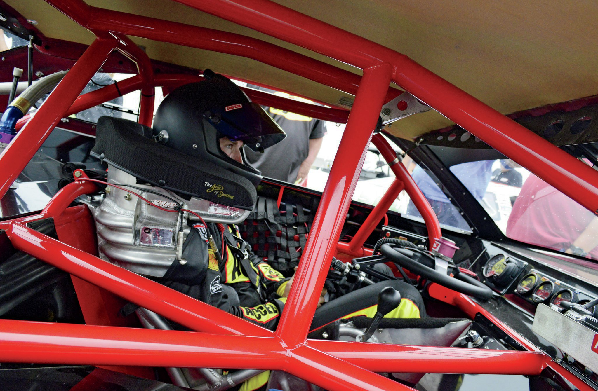 In this shot you can see how a properly designed and mounted seat holds a driver in place. Will favors a Joie of Seating seat built by former NASCAR Champion Randy LaJoie. Notice the reinforced ribbing on the backside of the seat, which adds strength and integrity to the whole system.