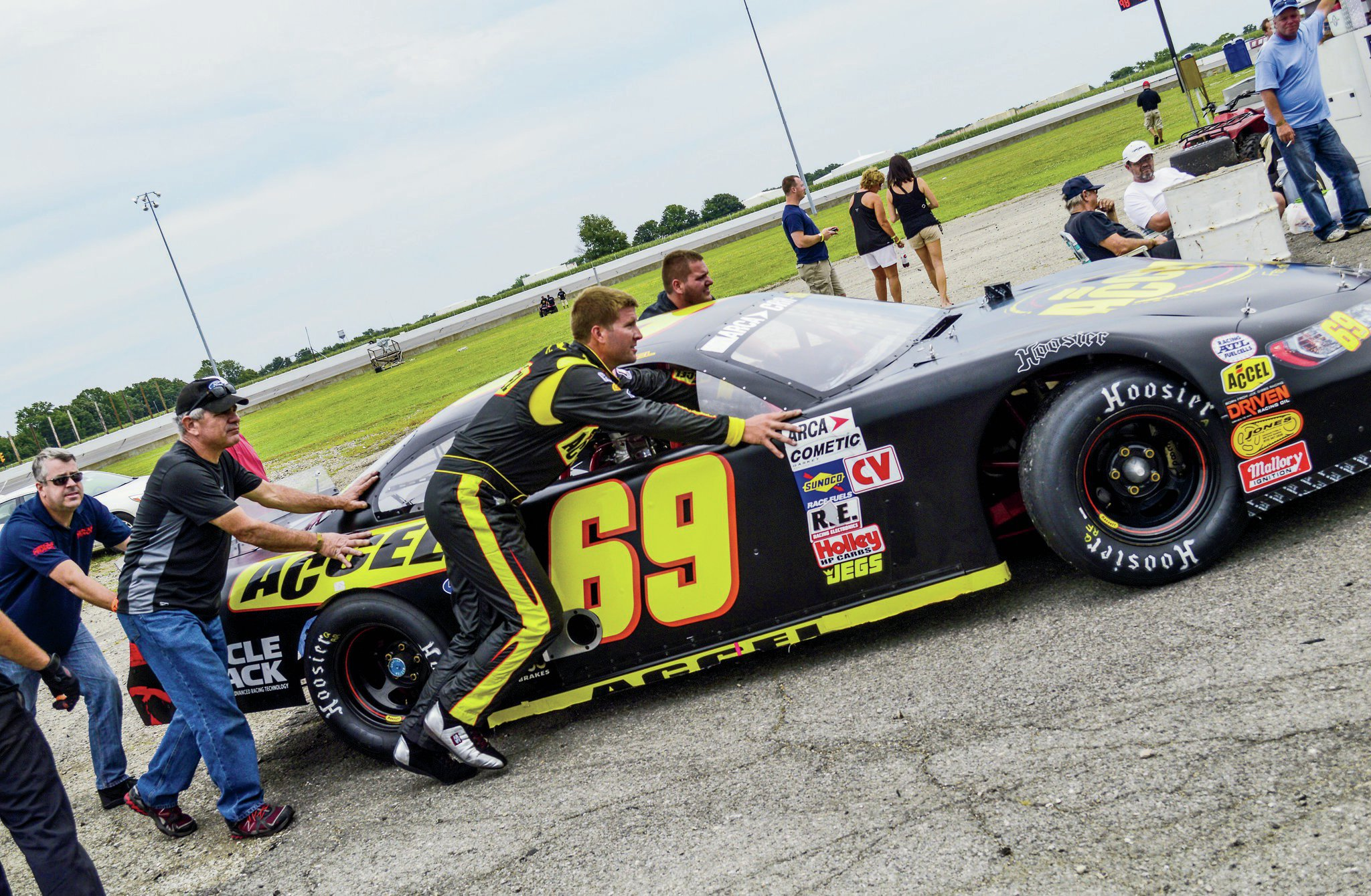 Will and the team push the car toward the scales for tech.