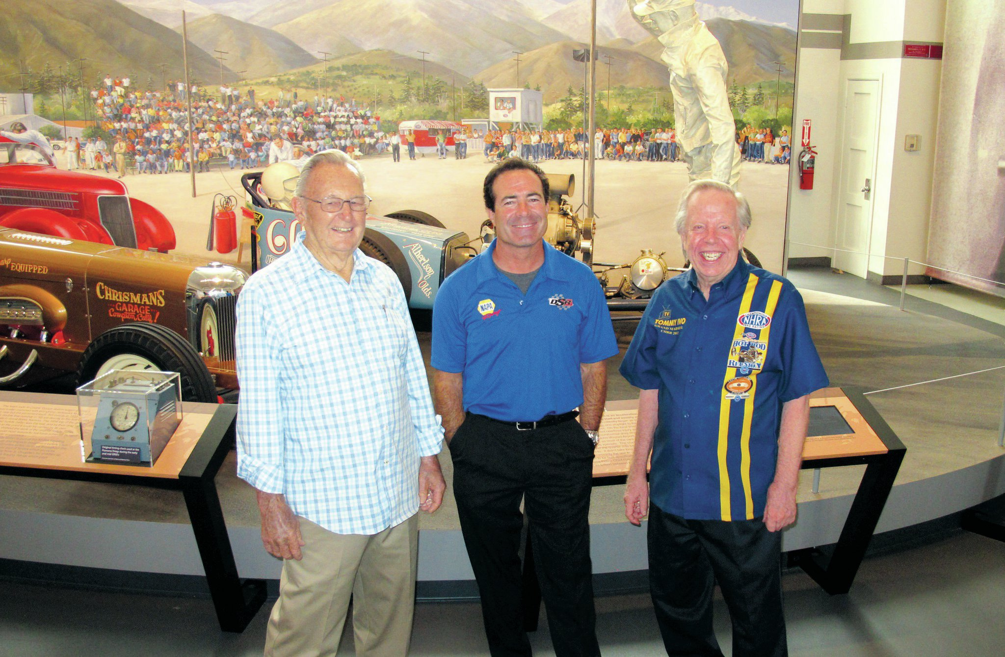 "Current NAPA Funny Car driver Ron Capps is flanked by Art Chrisman and Tommy Ivo. ""These guys were studs!"" Capps said of the pioneering racers."