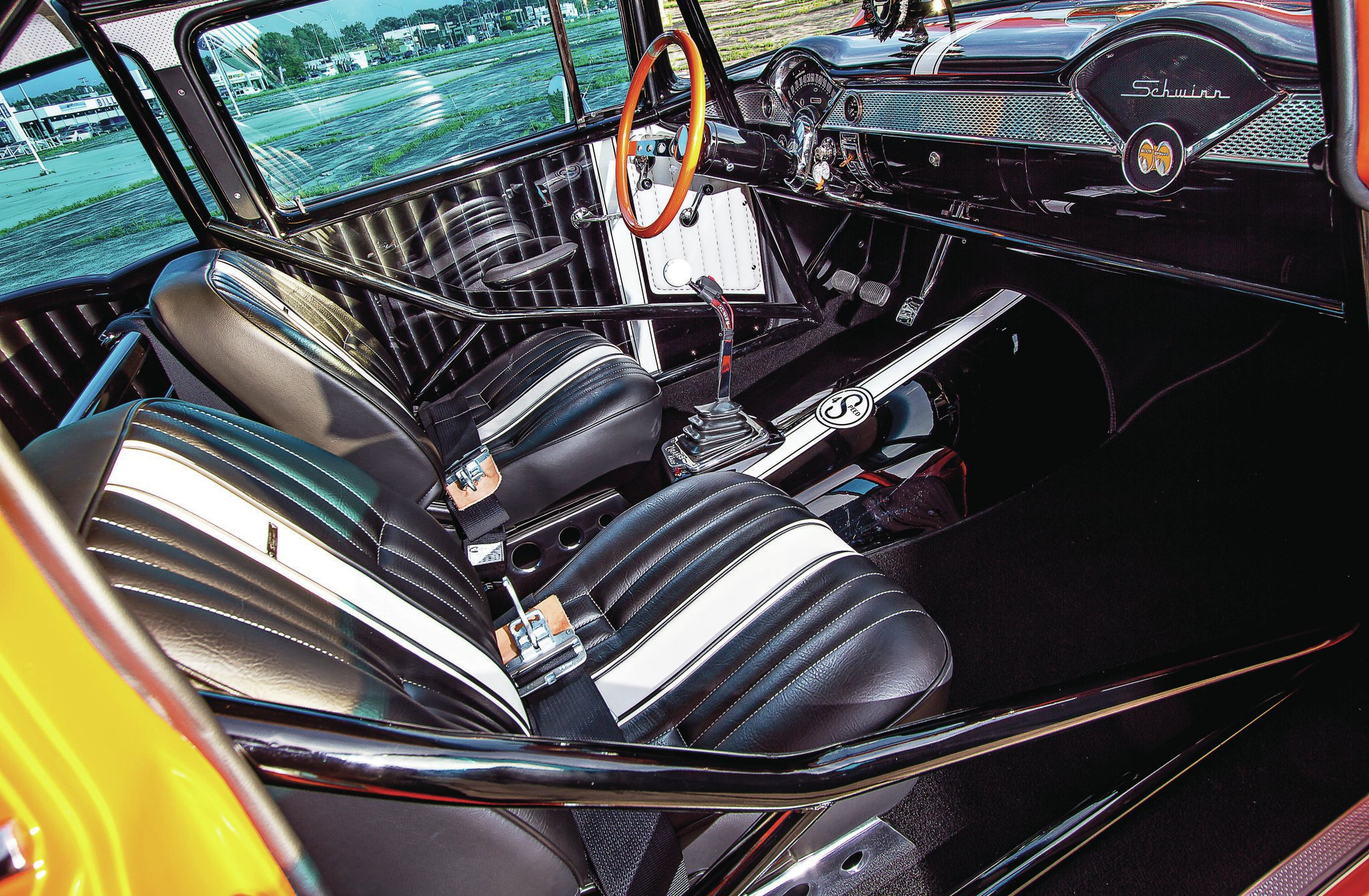 The door panels are the work of owner Dave VerSchave, who painted the aluminum panels to mimic actual upholstery. Schober's Custom Hot Rod Interiors aptly stitched the upholstery. Stick is a vintage Hurst shifter.