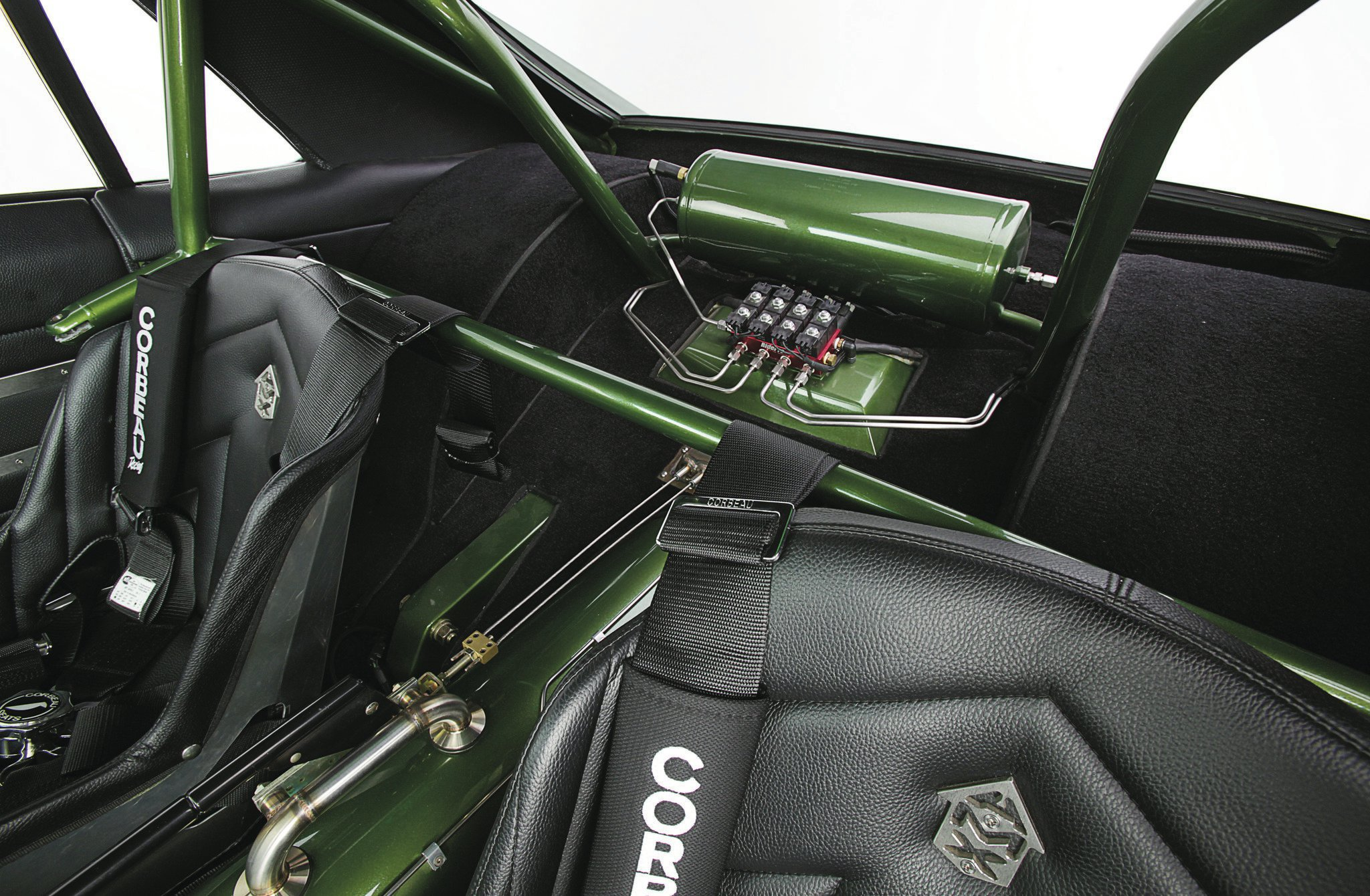 The integrated rollcage by RH Racecars in Kelowna, B.C., tucks nicely into the car. The air suspension tank and valves sit proudly under the rear window for all to get a look at.