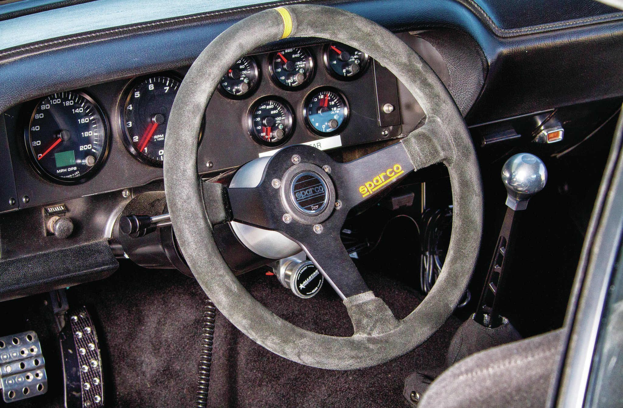 Speedhut gauges handle rpm and speedometer duty while an American Autowire system takes care of the wiring. The car uses a complete AIM Sports data-acquisition system to report back from the track.