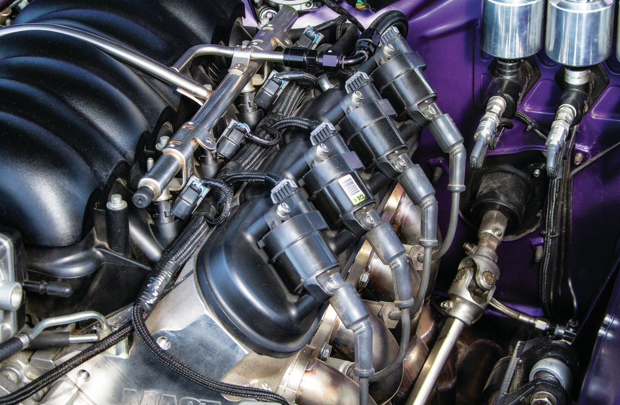Kooks stainless-steel longtube headers let the LS3 breathe into 3-inch Borla and custom X-pipe.