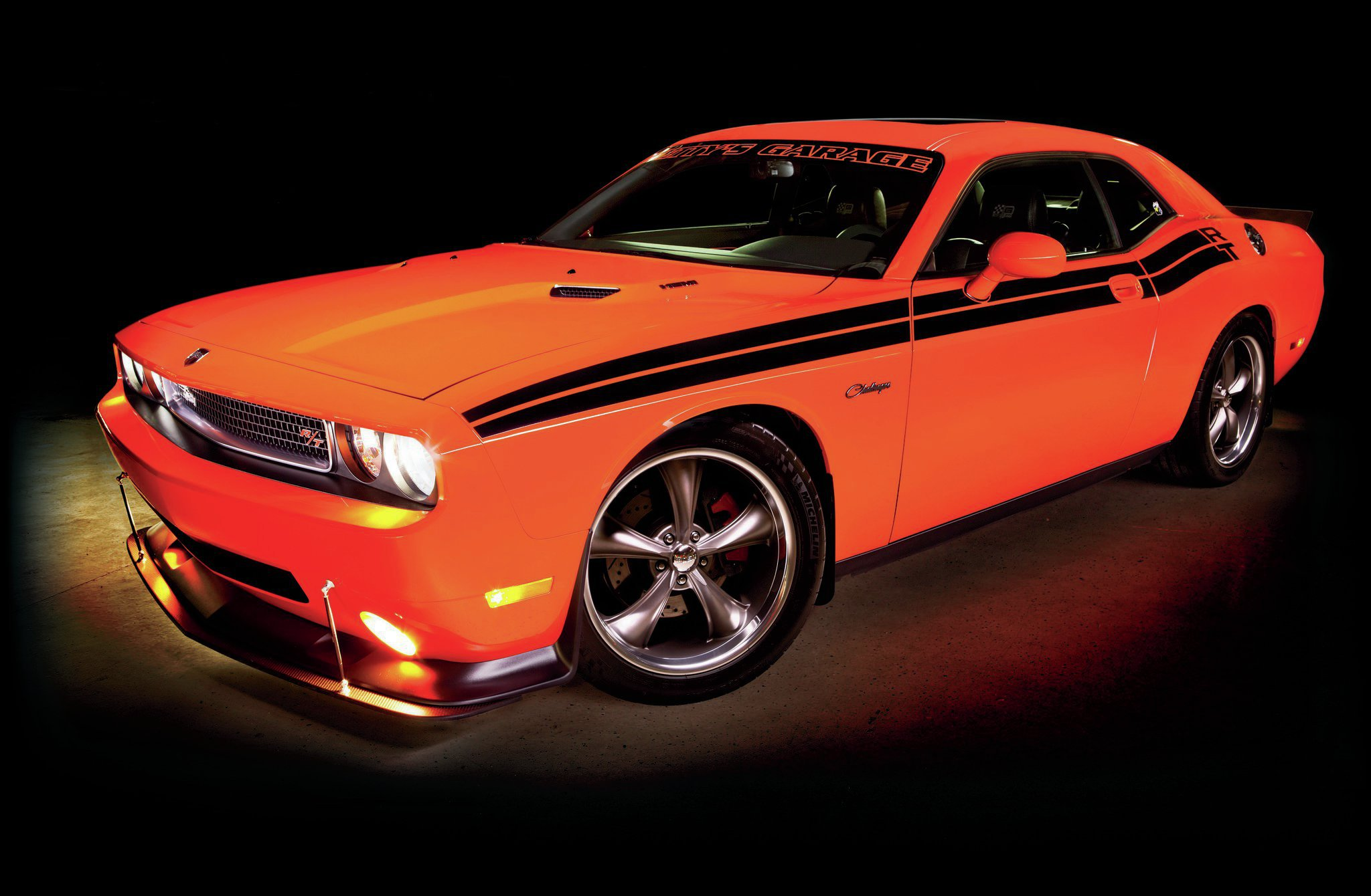 We love the clean integration of the air splitter with the air dam. The Challenger has the power to get up to high speeds in a hurry on track, and that package will help keep the front end pushed into the ground.