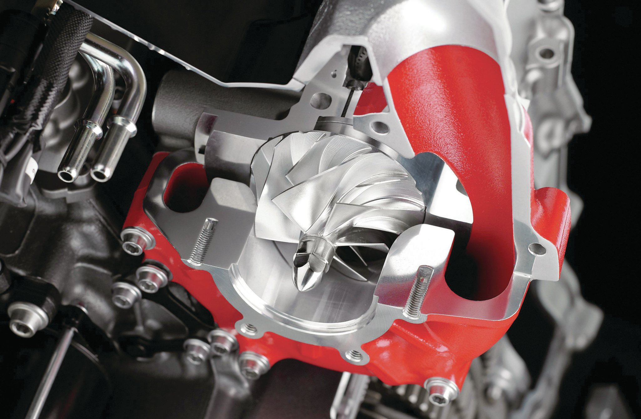 Kawasaki-built, geardriven centrifugal supercharger with a CNC-machined aluminum compressor wheel that spins up to 130,000 rpm, makes 20 psi of boost, and compresses 7 cubic feet of air per second into the engine without the need of an intercooler.
