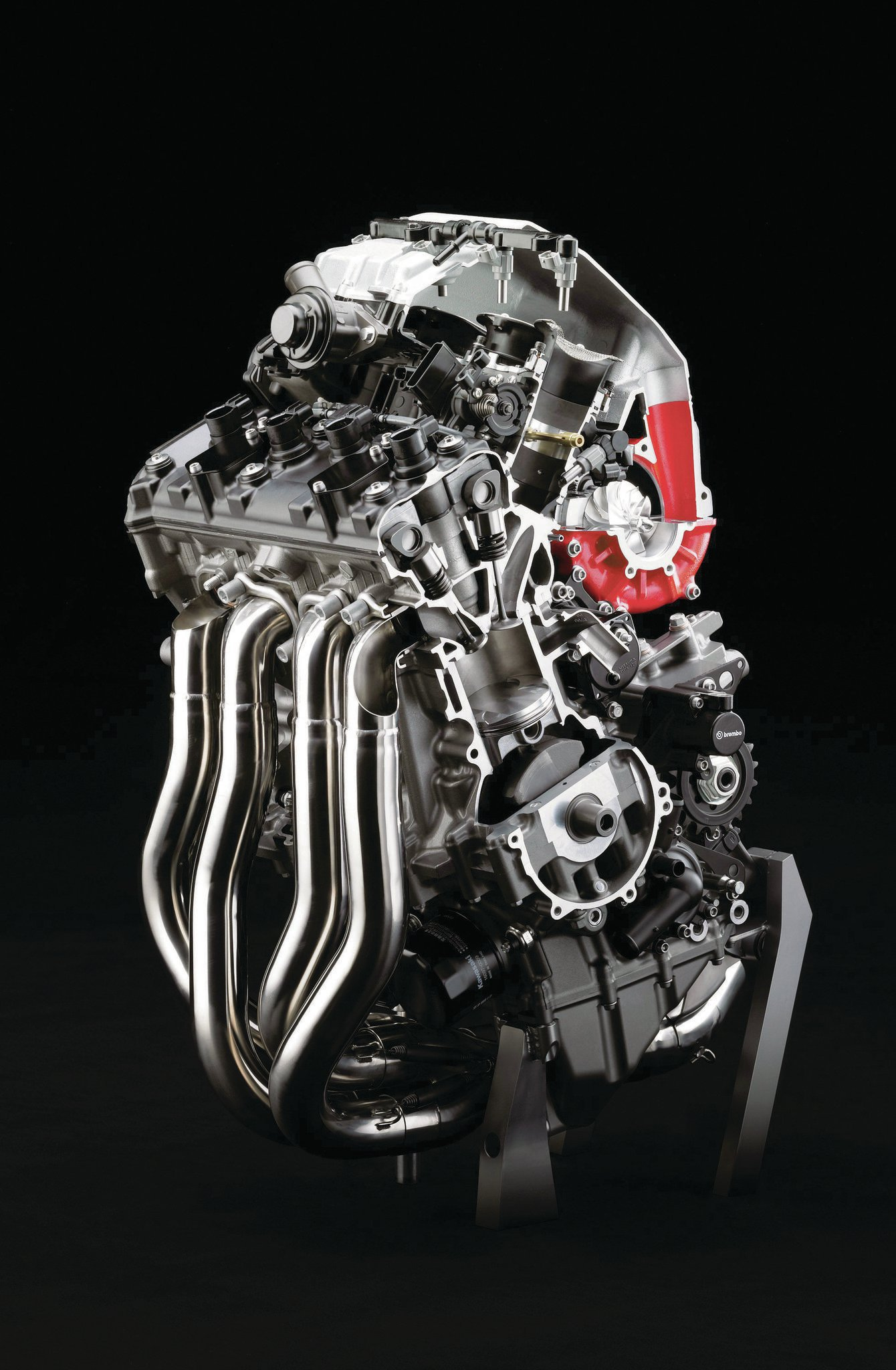 The 60.9ci (2.99-inch bore x 2.17-inch stroke), liquid-cooled, inline-four cylinder engine has a 8.3:1 compression ratio.