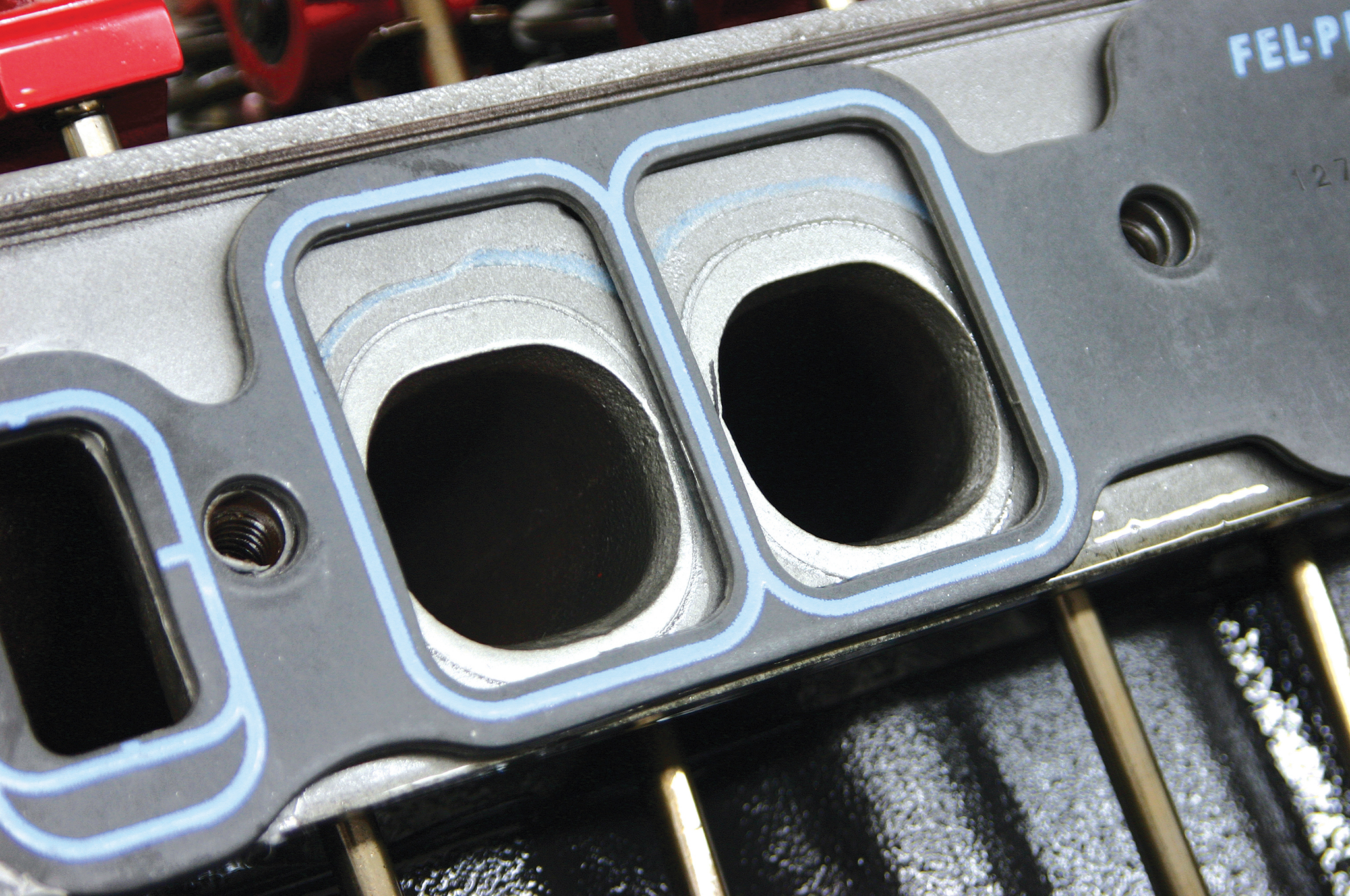 This picture illustrates the difference in port size between the so-called peanut-port big-block Chevy heads and the rectangle-port heads that were installed on performance engines. Oval-port castings have a port size somewhere in between the shape of these two.
