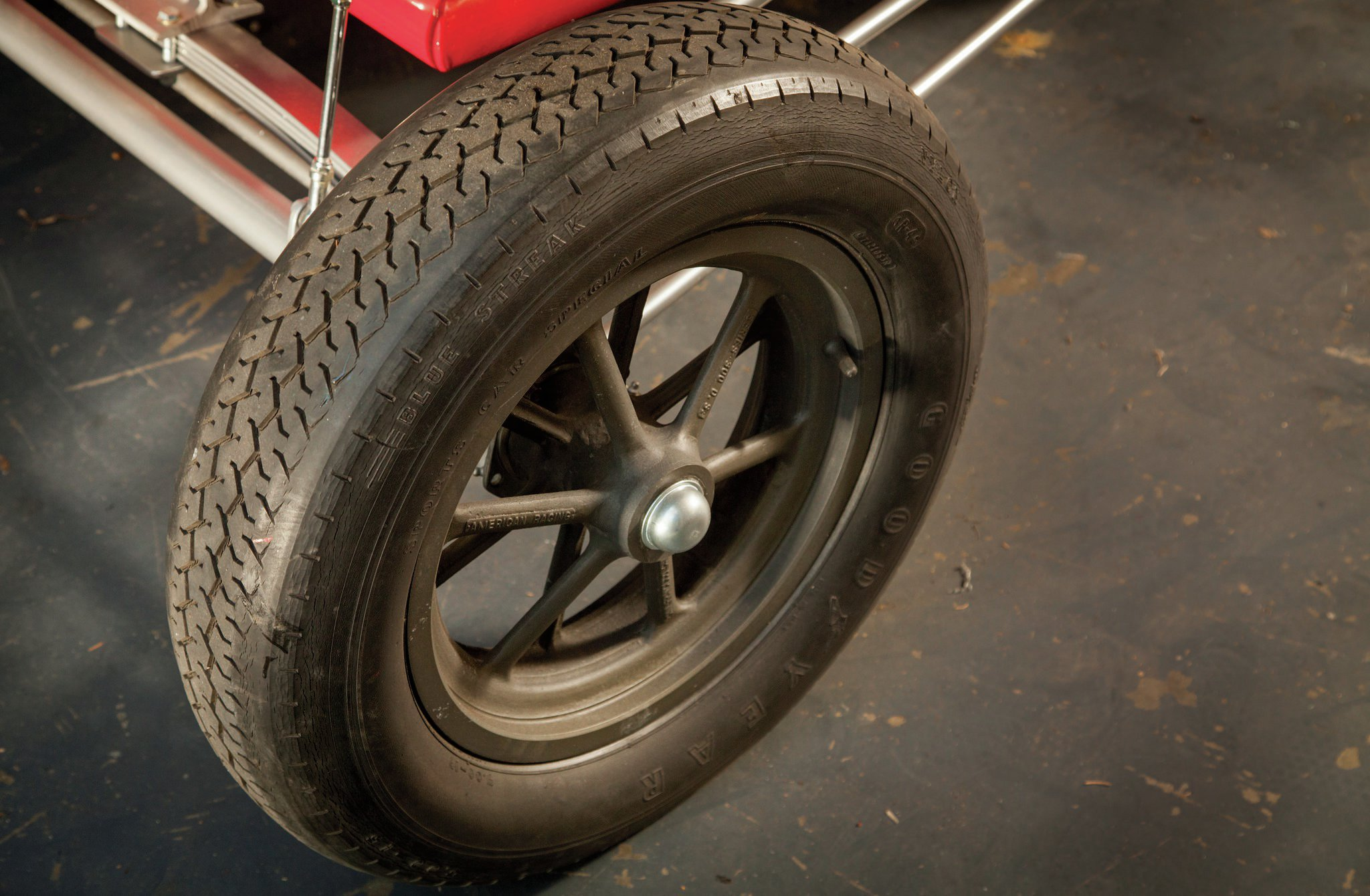 The vintage American 12-spoke front wheels were among the parts found in White's garage and restored to use on the car again.