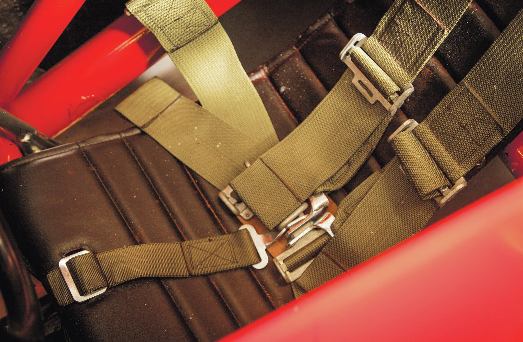 Rick White stitched up the cover for the metal seat and also supplied the belts.